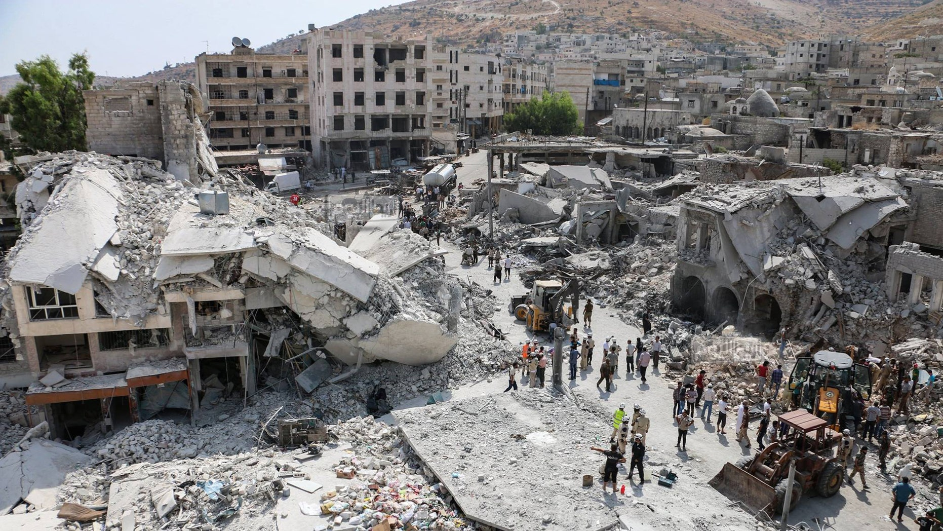 Aug. 3, 2015 - The scene after a government  warplane crashed in the center of the town of Ariha, in the northwestern province of Idlib, Syria. Air raids and the subsequent crash of a Syrian warplane in a residential area in the northwestern town of Ariha on Monday killed and wounded dozens of people, two activist groups said.
