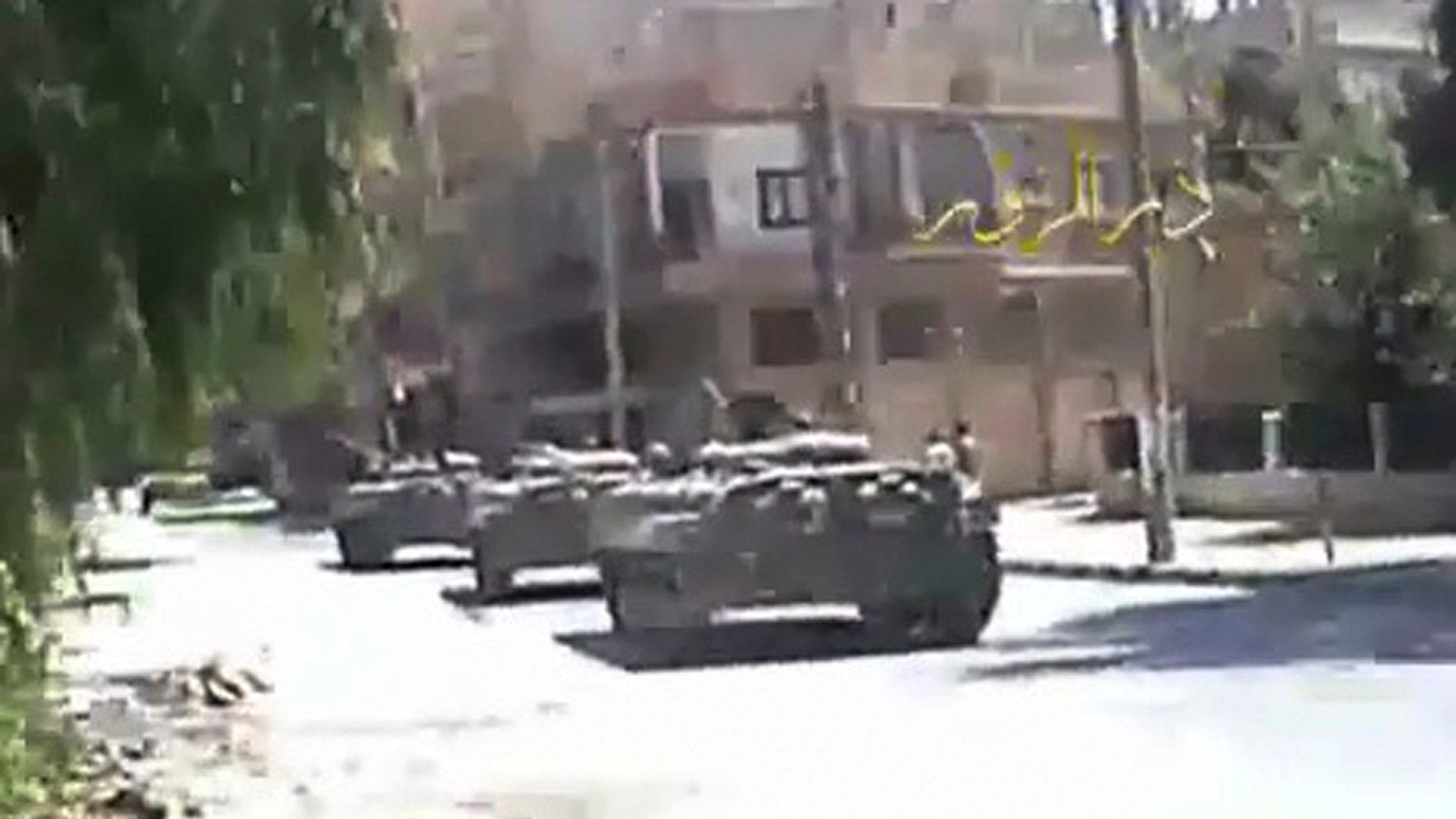 Aug. 10: In this image made from amateur video released by DPN (Deir el-Zour Press news) and accessed via The Associated Press Television News on Wednesday, shows Syria tanks on the street in Deir el-Zour, Syria on Tuesday Aug. 9. 2011. Syrian troops seized control of the eastern flashpoint city of Deir el-Zour Wednesday following intense shelling and gunfire, an activist said, as the international community intensified its pressure on the country's president to end the deadly crackdown.