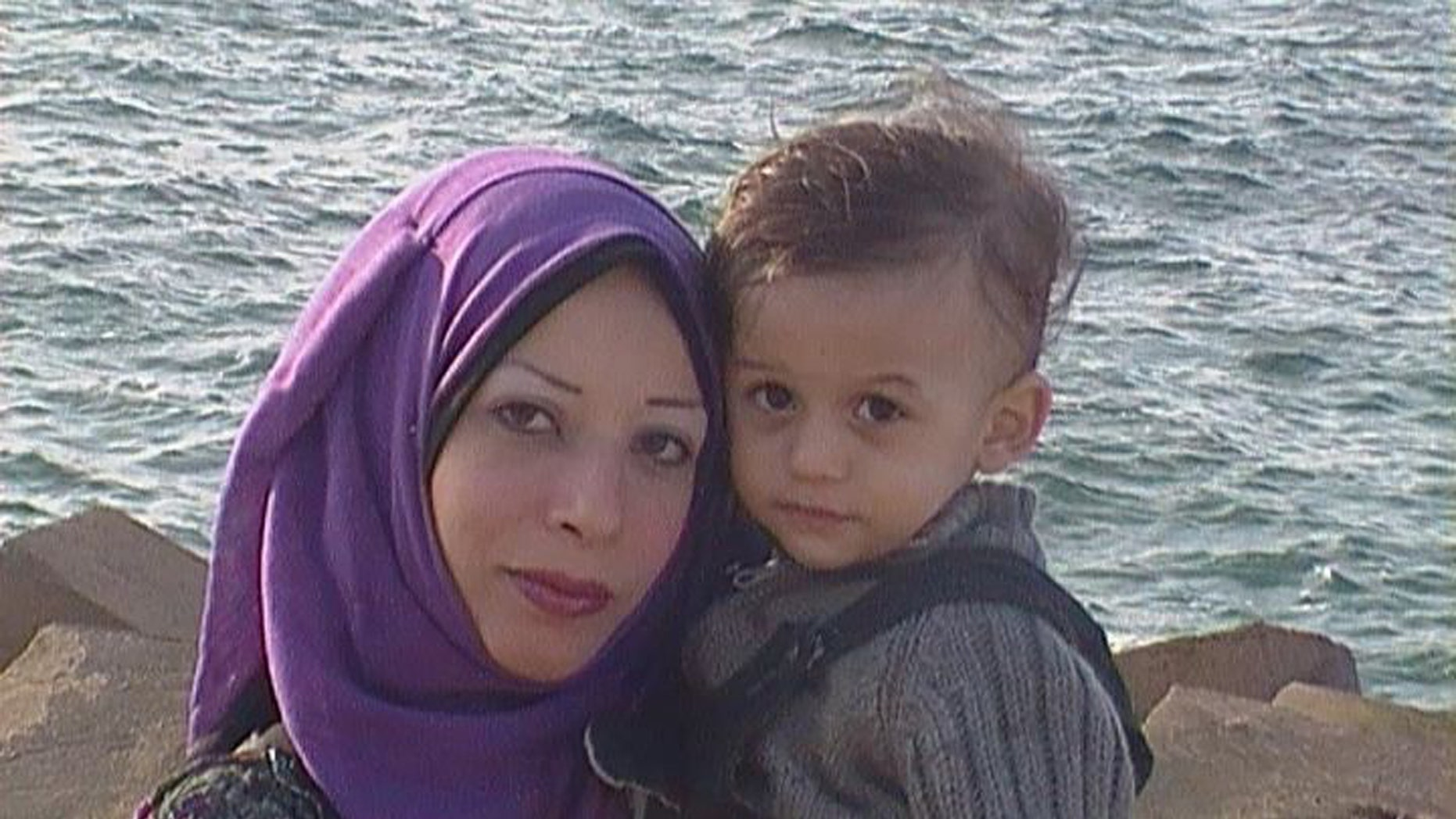 Mona al-Gharib, left, poses for a photo with an unidentified child. The 25-year-old pregnant wife of a Syrian dissident and journalist has been abducted in Egypt by Syrian intelligence agents, her husband said.