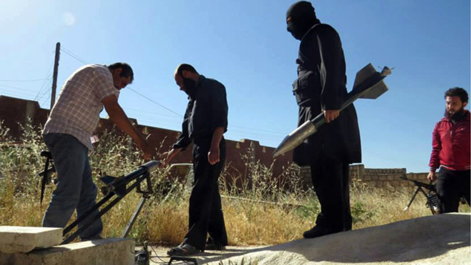 FILE: June 4, 2013: Syrian rebels preparing to fire locally made rockets, in Idlib province, northern Syria. (image by Edlib News Network and  authenticated on its contents and other reporting.)