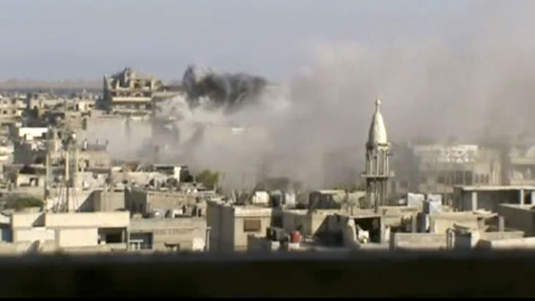 June 8, 2012: This image made from amateur video released by Shaam News Network purports to show explosions in the Khaldiyeh area of Homs, Syria.