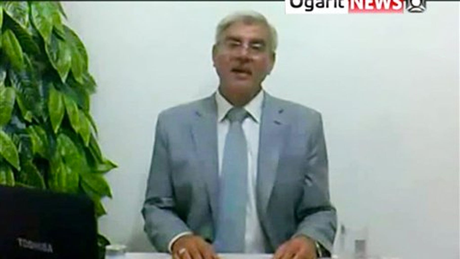 "September 1: Syrian attorney general for the central Hama province of Syria, Adnan Bakkour appears on a video posted online declaring his resignation to protest at what he said was President Bashar Assad's crackdown on a 5-month-old uprising, saying security forces killed hundreds of people in the restive city of Hama and arrested thousands of ""peaceful protesters."" The state-run news agency said Thursday that ""terrorists"" had kidnapped Bakkour and forced him to make the recording, although Bakkour denied this in a second video."