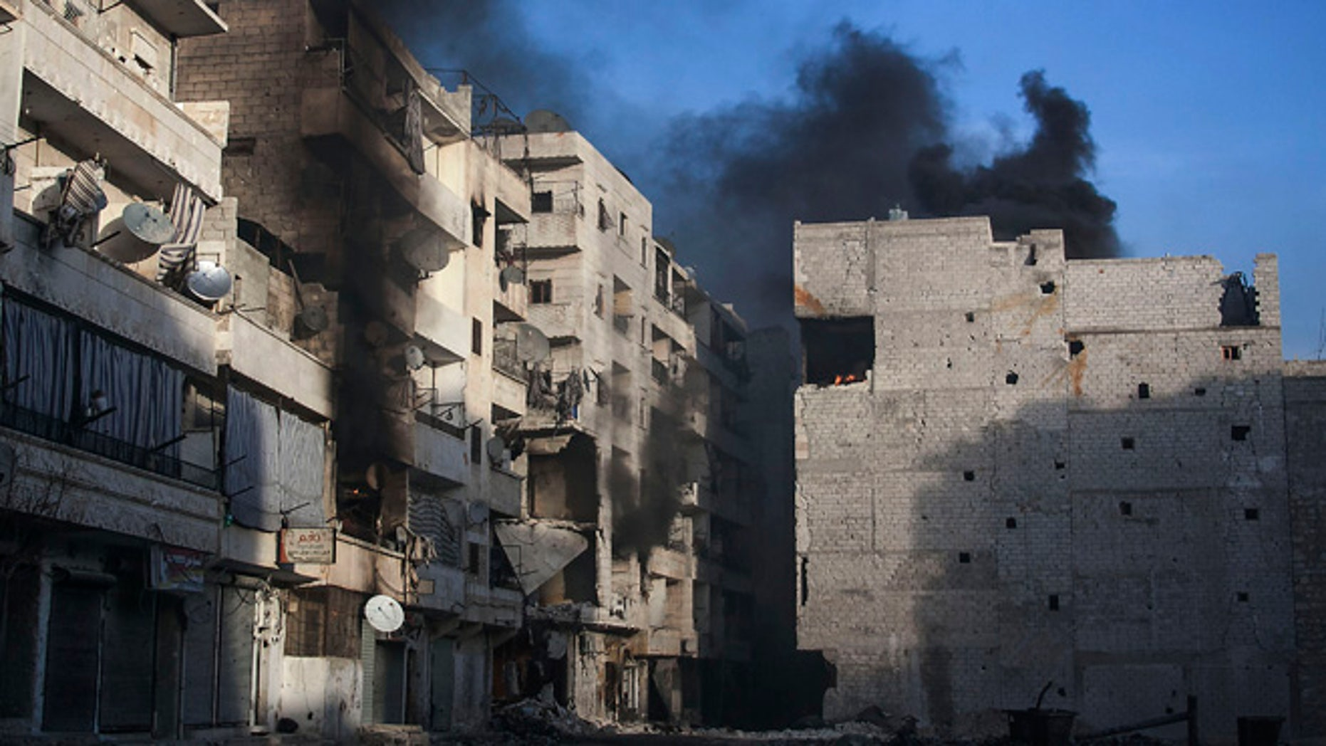 Dec. 5, 2012: Smoke rises from residential buildings due heavy fighting between Free Syrian Army fighters and government forces in Aleppo, Syria.