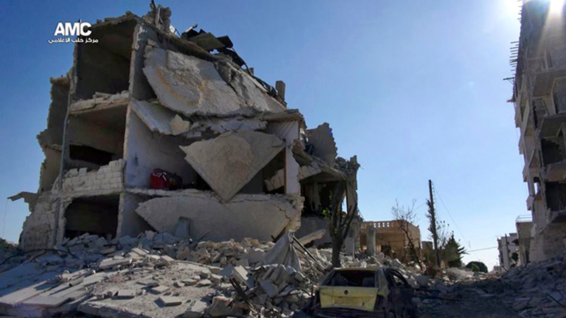 Sept. 16, 2013: This citizen journalism image provided by Aleppo Media Center AMC which has been authenticated based on its contents and other AP reporting, shows damaged buildings due to heavy fighting between government forces and Free Syrian Army fighters in Aleppo.