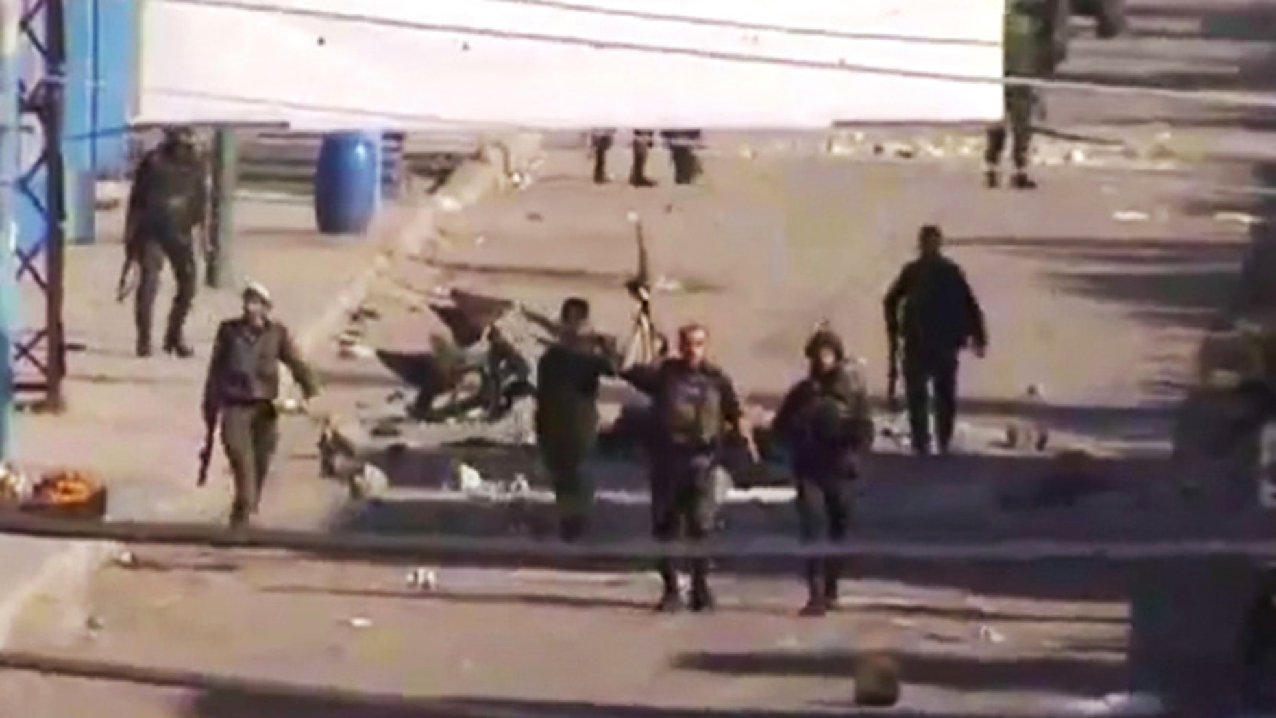 DEC. 19: In this image from TV shown on the internet made available by the Sham News Network, is believed to be soldiers walking down the street in Daraa, Syria.