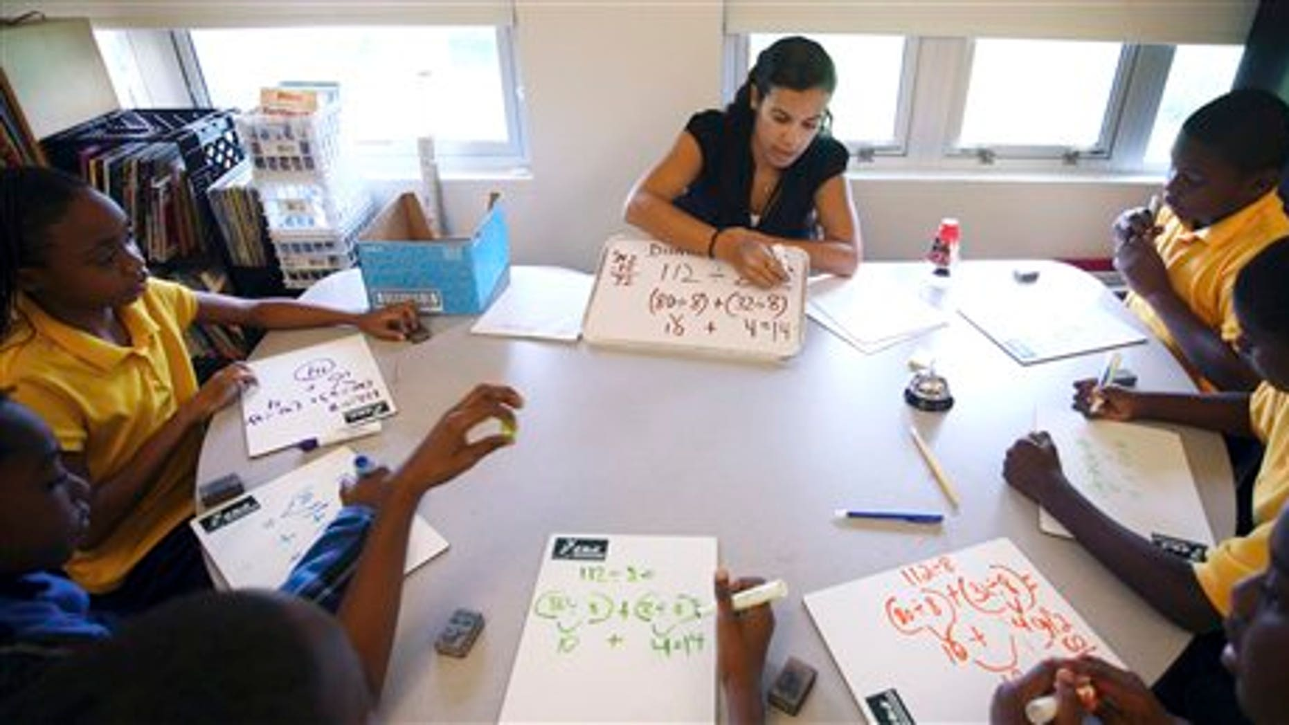 Sept. 1, 2011: Jennifer Mojica works with students in her math class at Holmes Elementary School in Miami.