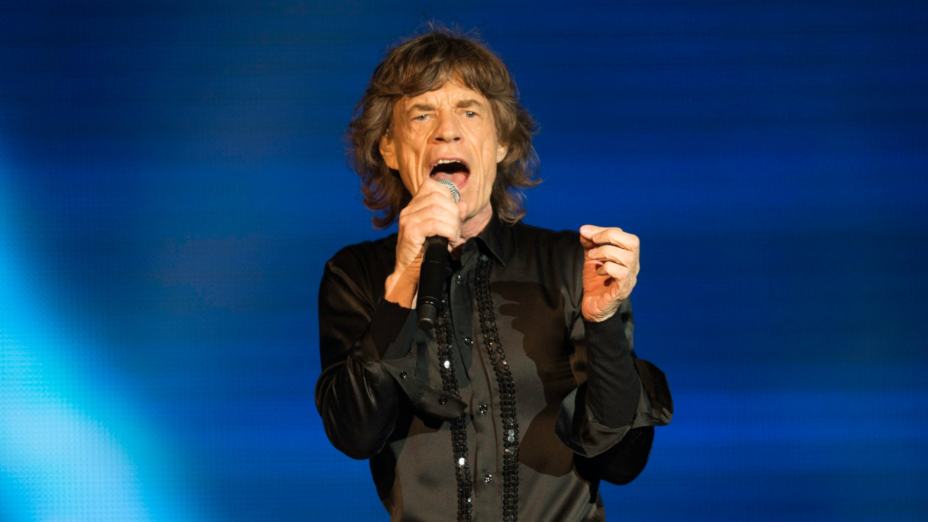 ABU DHABI, UNITED ARAB EMIRATES - FEBRUARY 21:  Mick Jagger of The Rolling Stones performs at du Arena, Yas Island on February 21, 2014 in Abu Dhabi, United Arab Emirates.  (Photo by Neville Hopwood/Getty Images)