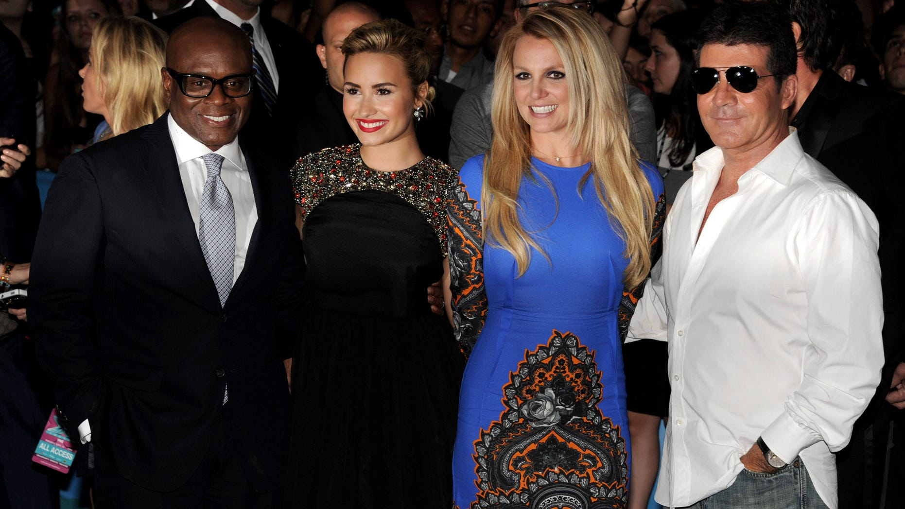 """LOS ANGELES, CA - SEPTEMBER 11:  The X Factor judges (L-R) L.A. Reid, Demi Lovato, Britney Spears and Simon Cowell pose at the premiere of Fox's """"The X Factor"""" Season 2 and handprint ceremony at the Chinese Theatre on September 11, 2012 in Los Angeles, California.  (Photo by Kevin Winter/Getty Images)"""