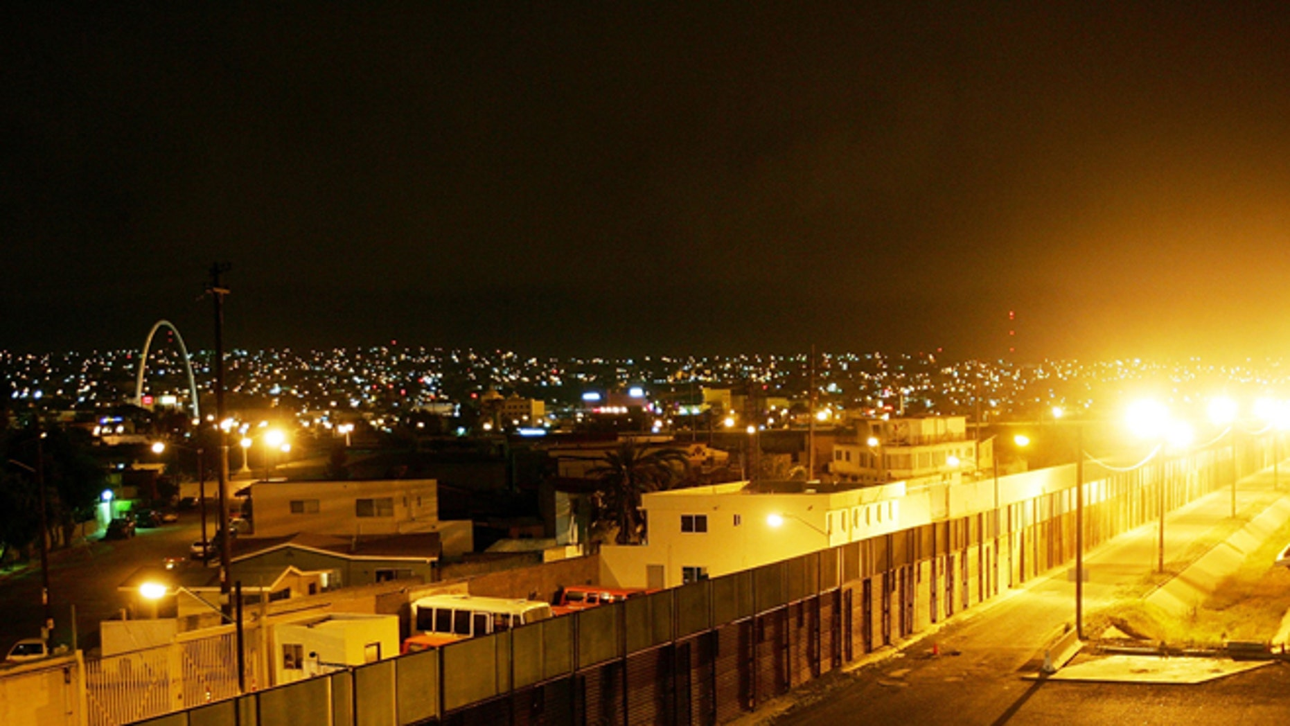 """TIJUANA, MEXICO - MAY 04:  The U.S.-Mexico border fence divides Tijuana (L) and the U.S. (R) in the early morning hours May 4, 2006 in Tijuana, Mexico. Mexican President Vicente Fox refused to sign a bill that would legalize the personal use of drugs and narcotics. The law would have been among the world's most permissive. On May 2, Fox's spokesman pledged the president would sign it but on May 3, hours after U.S. officials warned the plan could encourage """"drug tourism?, the president sent the measure back to Congress for changes, prompting the Mexican media to accuse Fox of bowing to U.S. pressure. The law would have allowed possession of personal amounts of drugs by anyone 18 or older, including cocaine, Ecstasy, LSD, marijuana, heroin, opium, and more than 2 pounds of peyote, the hallucinogenic cactus used in native religious ceremonies. In the last 18 months, more than 1,000 people have been killed in escalating violence over smuggling routes to the U.S. Police and journalists have also become increasingly frequent targets, with automatic weapons and explosives becoming common tools of the trade.  (Photo by David McNew/Getty Images)"""