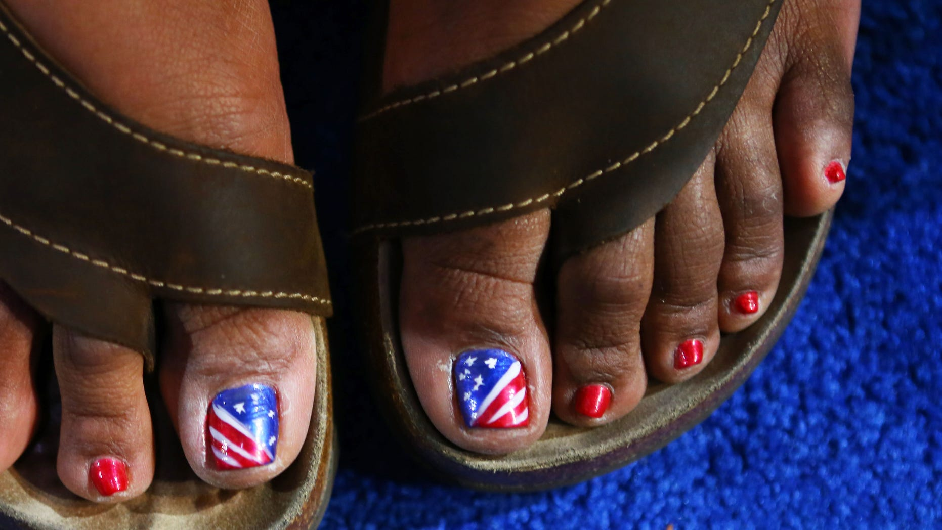 CHARLOTTE, NC - SEPTEMBER 05:  Anita White of Virginia has her toenails painted red, white, and blue during day two of the Democratic National Convention at Time Warner Cable Arena on September 5, 2012 in Charlotte, North Carolina. The DNC that will run through September 7, will nominate U.S. President Barack Obama as the Democratic presidential candidate.  (Photo by Joe Raedle/Getty Images)