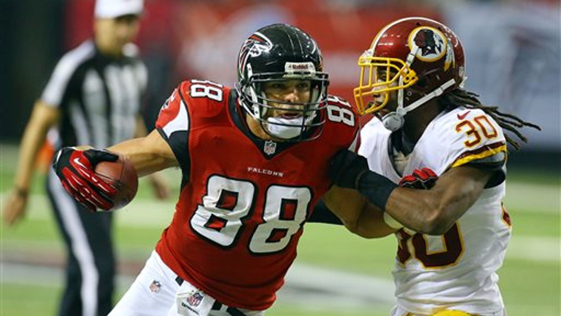 Atlanta Falcons tight end Tony Gonzalez (88) catches a pass against Washington Redskins cornerback E.J. Biggers during the second half of an NFL football game on Sunday, Dec. 15, 2013, in Atlanta. (AP Photo/Atlanta Journal-Constitution, Curtis Compton) MARIETTA DAILY OUT, GWINNETT DAILY POST OUT) LOCAL TV OUT (WXIA, WGCL, FOX 5)