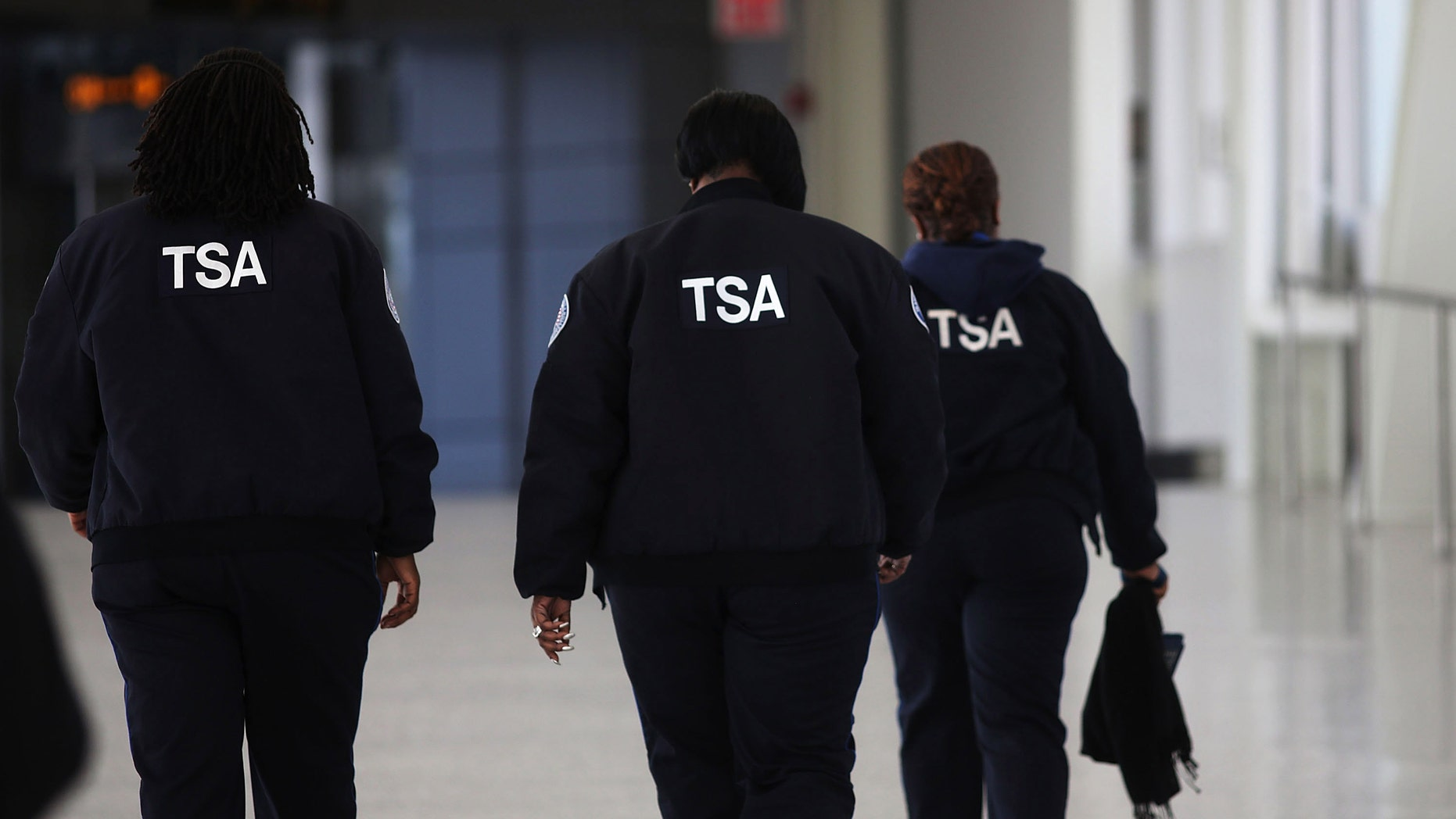 NEW YORK, NY - FEBRUARY 28:  Transportation Security Administration (TSA) workers walk through John F. Kennedy Airport on February 28, 2013 in New York City. Should the $85 billion in automatic federal budget cuts, known as the sequester, go into effect Friday as scheduled, airport control towers in a number of states could close, putting pilots and staff members at risk. In addition to the closed control towers, TSA workers could be furloughed, leading to long waits and confusion at many airport security checkpoints.  (Photo by Spencer Platt/Getty Images)