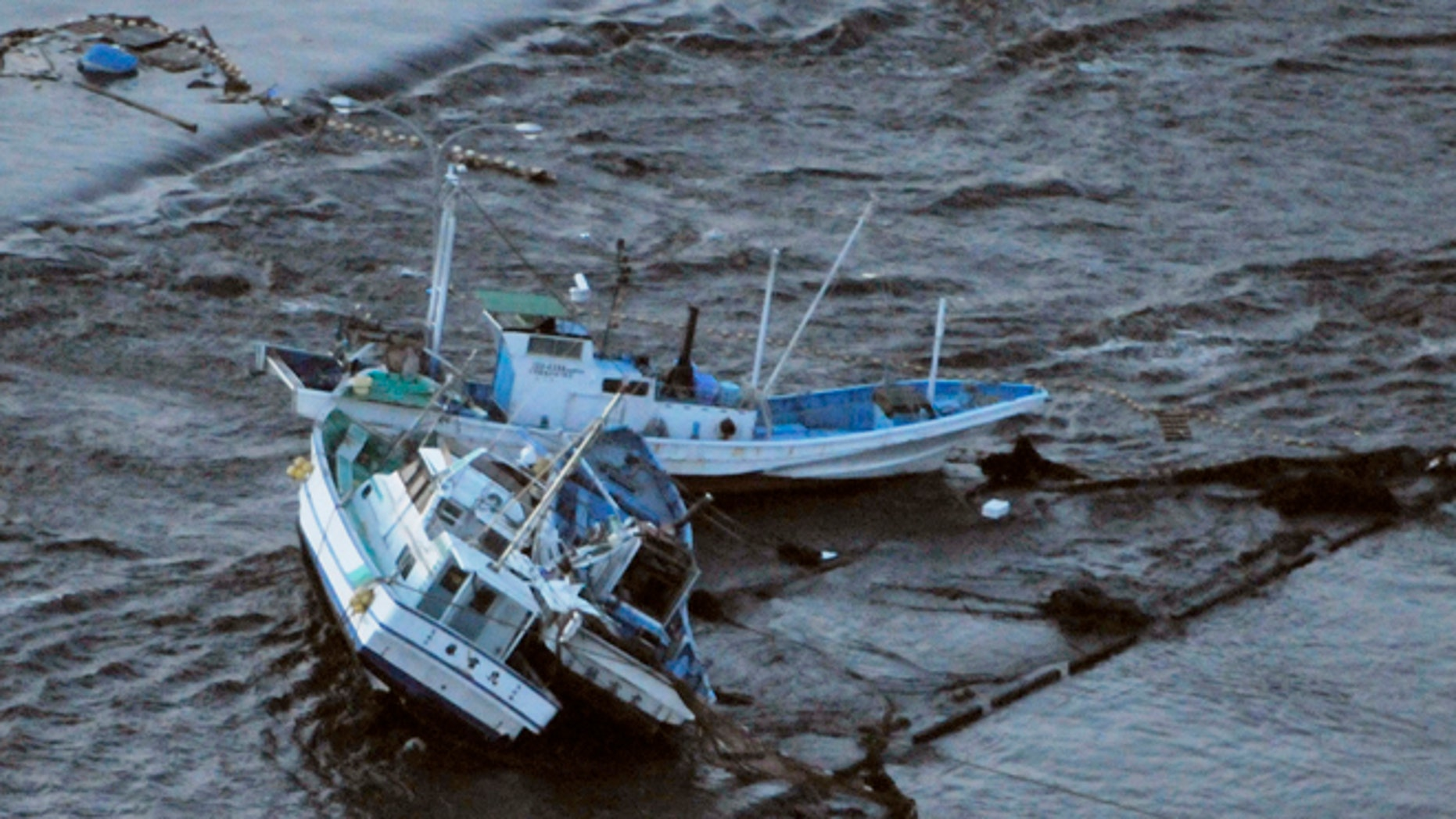 March 11: Fishing boats get stranded on shore at Oarai town, Ibaraki prefecture (state), Japan, after a ferocious tsunami spawned by one of the largest earthquakes ever recorded slammed Japan's eastern coasts.