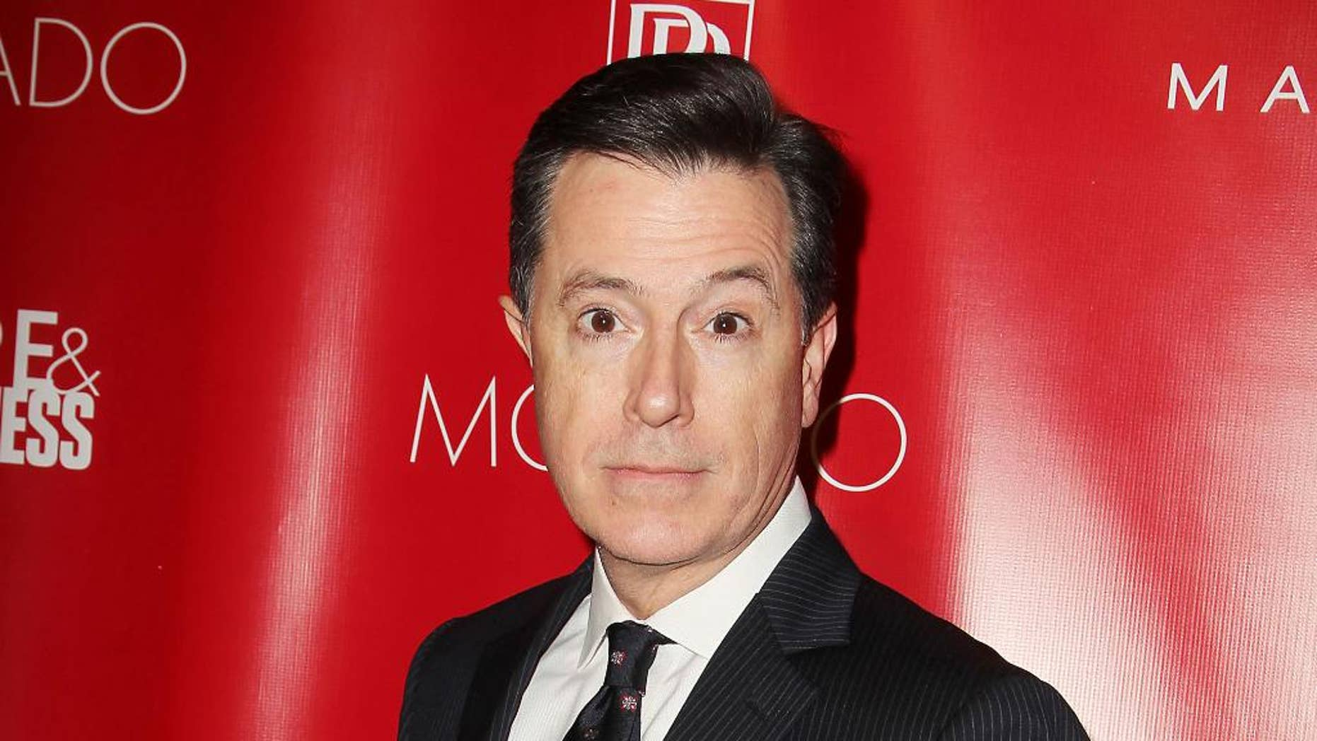 "FILE - This Jan. 31, 2014 file image released by Starpix shows Stephen Colbert at the Shape Magazine and Men's Fitness Super Bowl Party in New York. Colbert will not only be following in David Letterman's footsteps, he'll be doing it on the same stage. CBS said Wednesday, July 23, that Colbert, who is replacing Letterman as the ""Late Show"" host next year, will keep the show in New York City's Ed Sullivan Theatre. Colbert's debut date is still uncertain, dependent on when Letterman officially retires from late-night TV.  (AP Photo/Starpix, Amanda Schwab, File)"