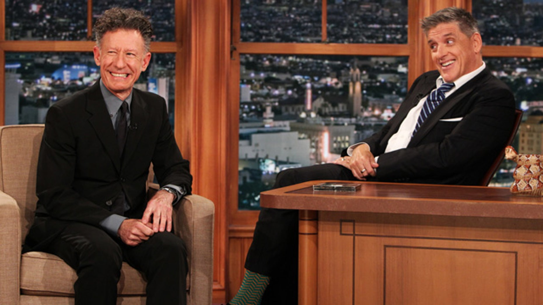 April 23, 2014: This photo released by CBS shows Lyle Lovett, left, and Craig Ferguson on 'The Late Late Show with Craig Ferguson' on the CBS Television Network. Ferguson says he is stepping down as host of the show this year. CBS said that Ferguson made the announcement to his studio audience. (AP Photo/CBS, Sonja Flemming)