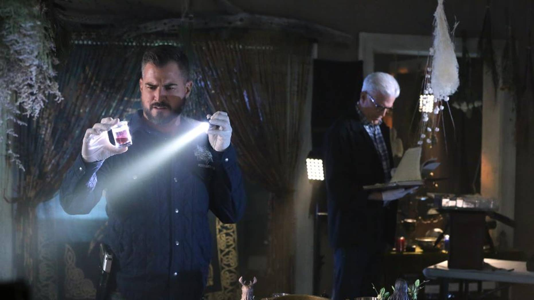 """In this image released by CBS, George Eads, left, and Ted Danson appear in a scene from """"CSI: Crime Scene Investigation."""" """"CSI,"""" which debuted in 2000, will wrap with a two-hour finale on Sept. 27. Original cast members including William Petersen and Marg Helgenberger are returning for the send-off. (Michael Yarish/CBS  via AP)"""