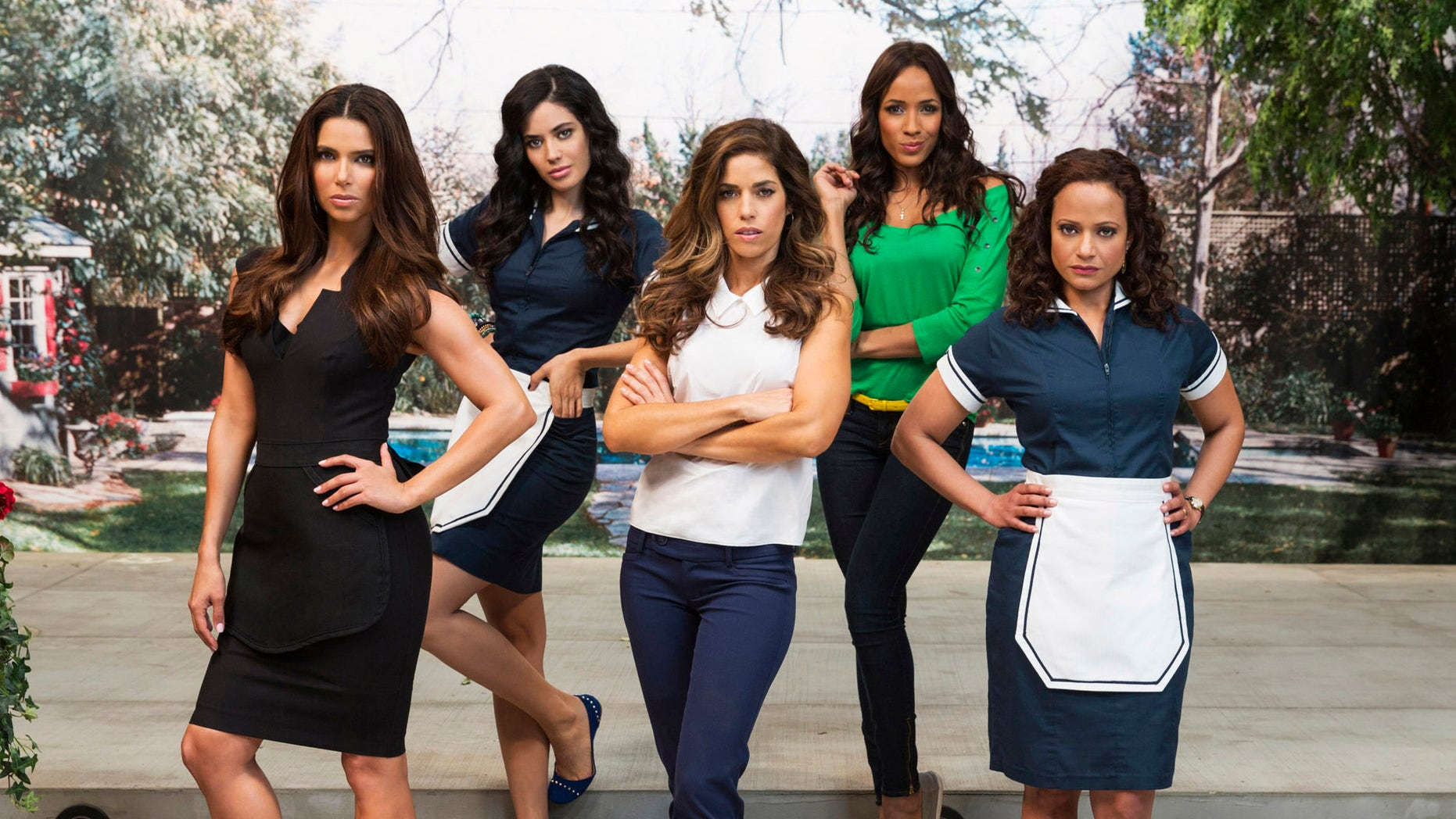 """FILE - This undated file photo released by Lifetime Television shows, from left, Roselyn Sanchez, Edy Ganem, Ana Ortiz, Dania Ramirez and Judy Reyes who star in the new Lifetime series """"Devious Maids."""" The series, about the lives of domestic workers and their wealthy bosses, was created by Marc Cherry, who also created the popular series, """"Desperate Housewives."""" (AP Photo/Lifetime Television, Jim Fiscus, File)"""