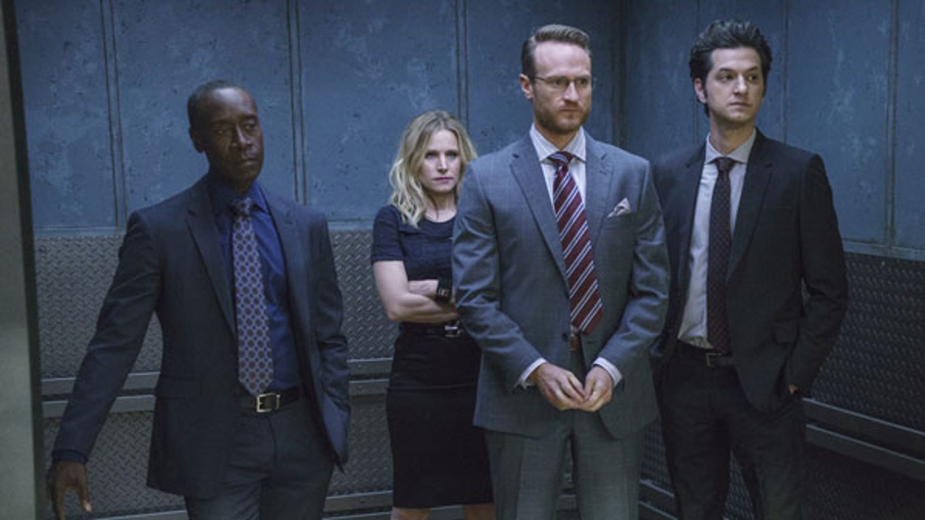 """In this image released by Showtime, Don Cheadle as Marty Kaan, from left, Kristen Bell as Jeannie Van Der Hooven, Ben Schwartz as Clyde Oberholt and Josh Lawson as Doug Guggenheim appear in a scene from, """"House of Lies."""" The Showtime comedy is wrapping its five-season run with a finale filmed entirely on location in Havana. The episode, titled âNo Es Facil,â premieres June 13. (Michael Desmond/Showtime via AP)"""