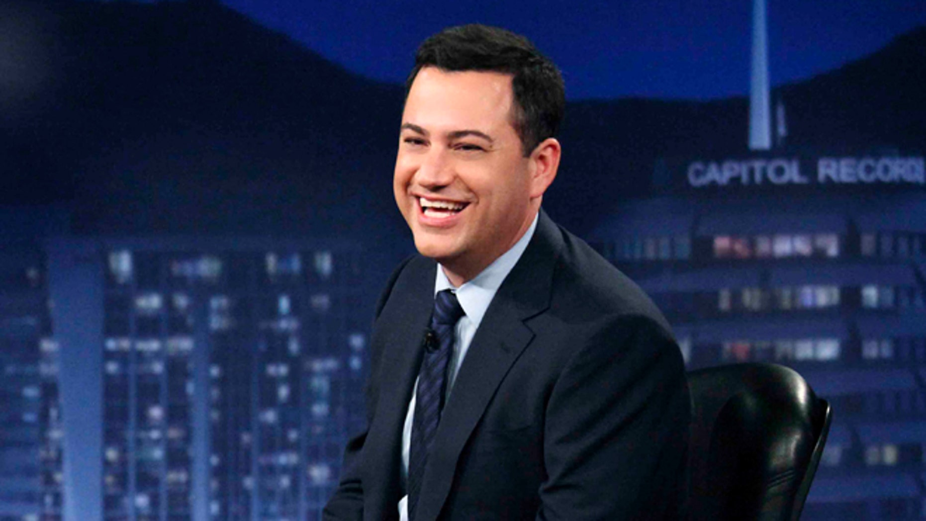 """This July 25, 2012 photo released by ABC shows Jimmy Kimmel hosting his late night show """"Jimmy Kimmel Live,"""" in the Hollywood section of Los Angeles."""