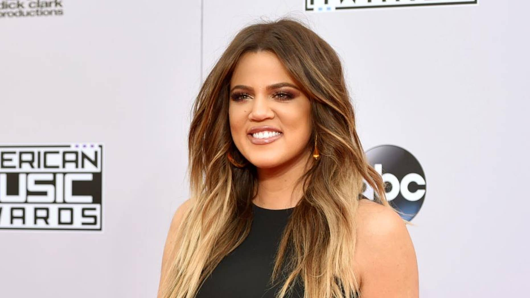"""FILE - In this Nov. 23, 2014 file photo, Khloe Kardashian arrives at the 42nd annual American Music Awards in Los Angeles. FYI, a division of A+E Networks, has ordered the new primetime, hybrid talk series """"Kocktails with Khloe"""" from Pilgrim Studios. (Photo by John Shearer/Invision/AP, File)"""