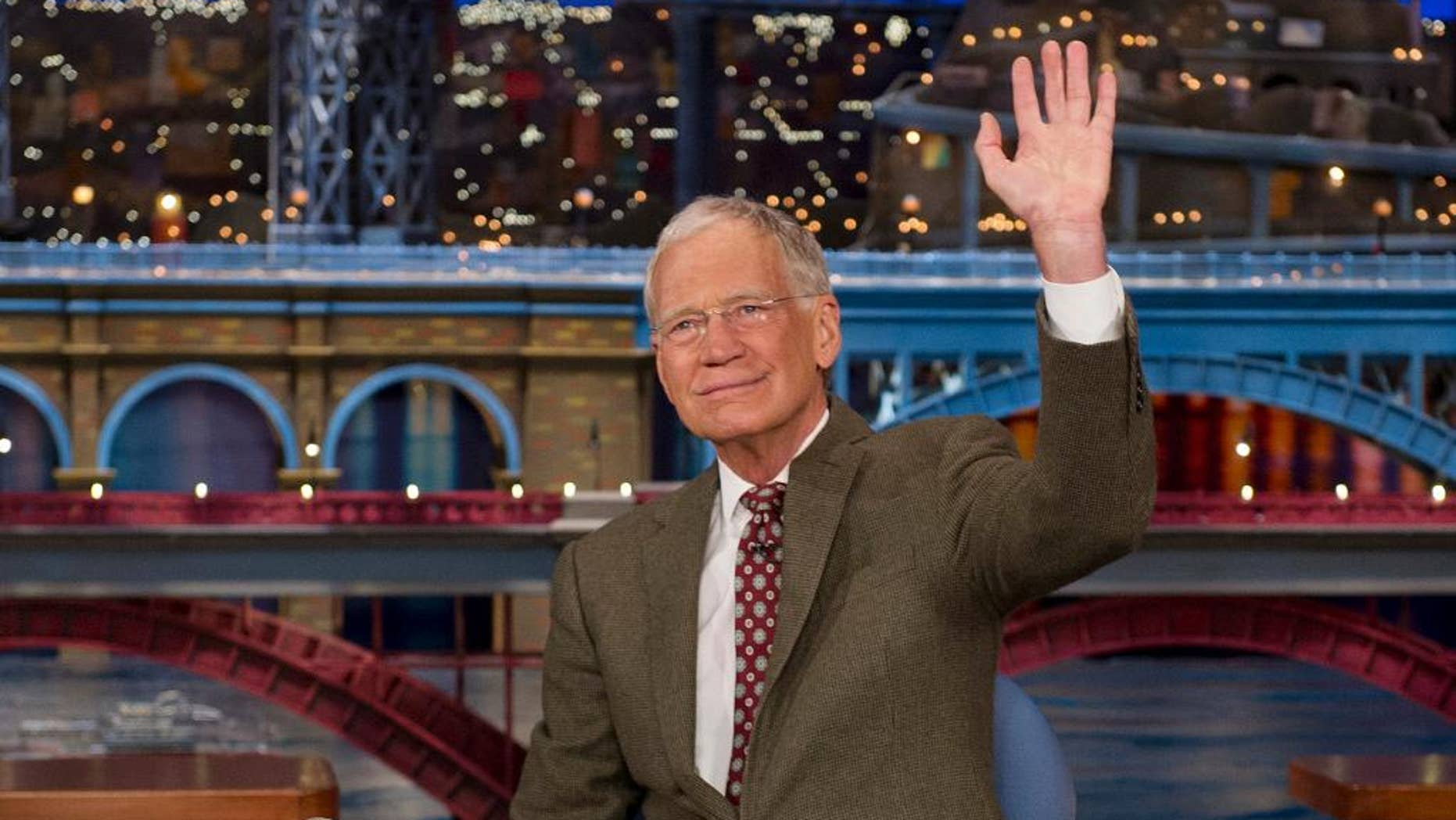 "FILe - In this April 3, 2014 file photo provided by CBS, David Letterman, host of the ""Late Show with David Letterman,"" waves to the audience in after announcing his retirement during a taping in New York. Letterman will host his final show on May 20. (AP Photo/CBS, Jeffrey R. Staab) MANDATORY CREDIT, NO SALES, NO ARCHIVE, FOR NORTH AMERICAN USE ONLY"