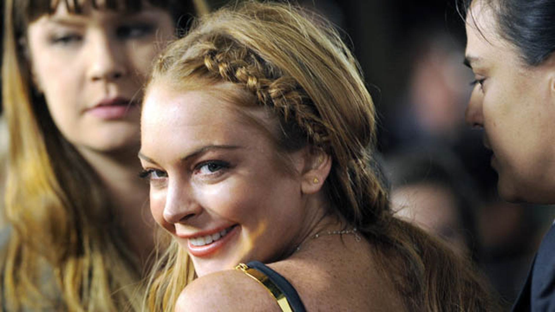 "FILE - This April 11, 2013 file photo shows actress Lindsay Lohan, a cast member in ""Scary Movie V,"" at the premiere of the film in Los Angeles. (Photo by Chris Pizzello/Invision/AP, File)"