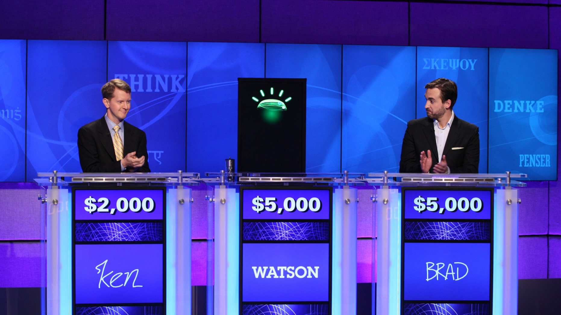 In this undated publicity image released by Jeopardy Productions, Inc., contestants Ken Jennings, left, and Brad Rutter and a computer named Watson compete on the game show 'Jeopardy!' in Yorktown Heights, N.Y.  (AP)