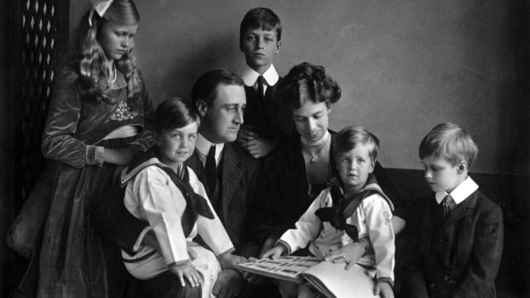 In this June 12, 1919 photo provided by PBS, Franklin and Eleanor Roosevelt pose for a portrait with their children in Washington.