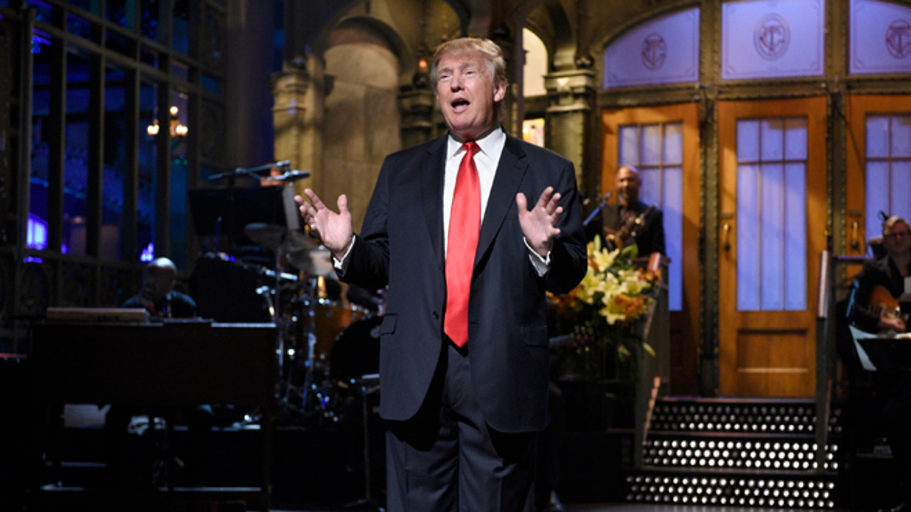 """Republican presidential candidate Donald Trump speaks as guest host during the monologue on """"Saturday Night Live"""", Saturday, Nov. 7, 2015. Trump's 90 minutes in the """"SNL"""" spotlight followed weeks of growing anticipation, increasingly sharp criticism and mounting calls for him to be dropped from the show.  (Dana Edelson/NBC via AP)"""