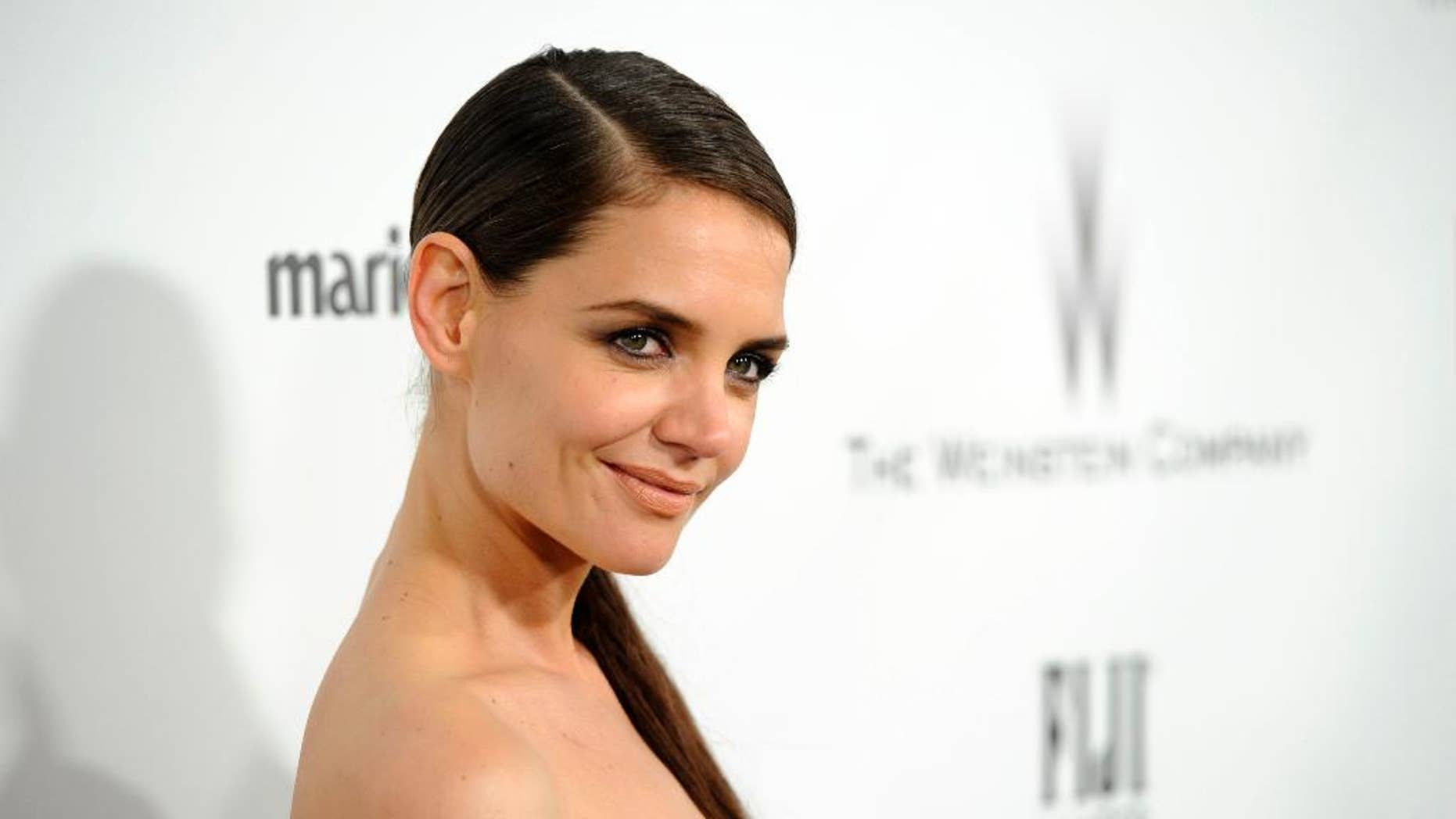 """FILE - In this Jan. 11, 2015 file photo, Katie Holmes arrives at The Weinstein Company and Netflix Golden Globes afterparty at the Beverly Hilton Hotel in Beverly Hills, Calif. Holmes is joining the Showtime drama """"Ray Donovan"""" for its upcoming third season. The former """"Dawson's Creek"""" star will play the businesswoman Paige, a daughter of billionaire producer Andrew Finney, who is portrayed by Ian McShane. Finney enlists the services of the show's title character, a Hollywood fixer played by Liev Schreiber. (Photo by Chris Pizzello/Invision/AP, File)"""