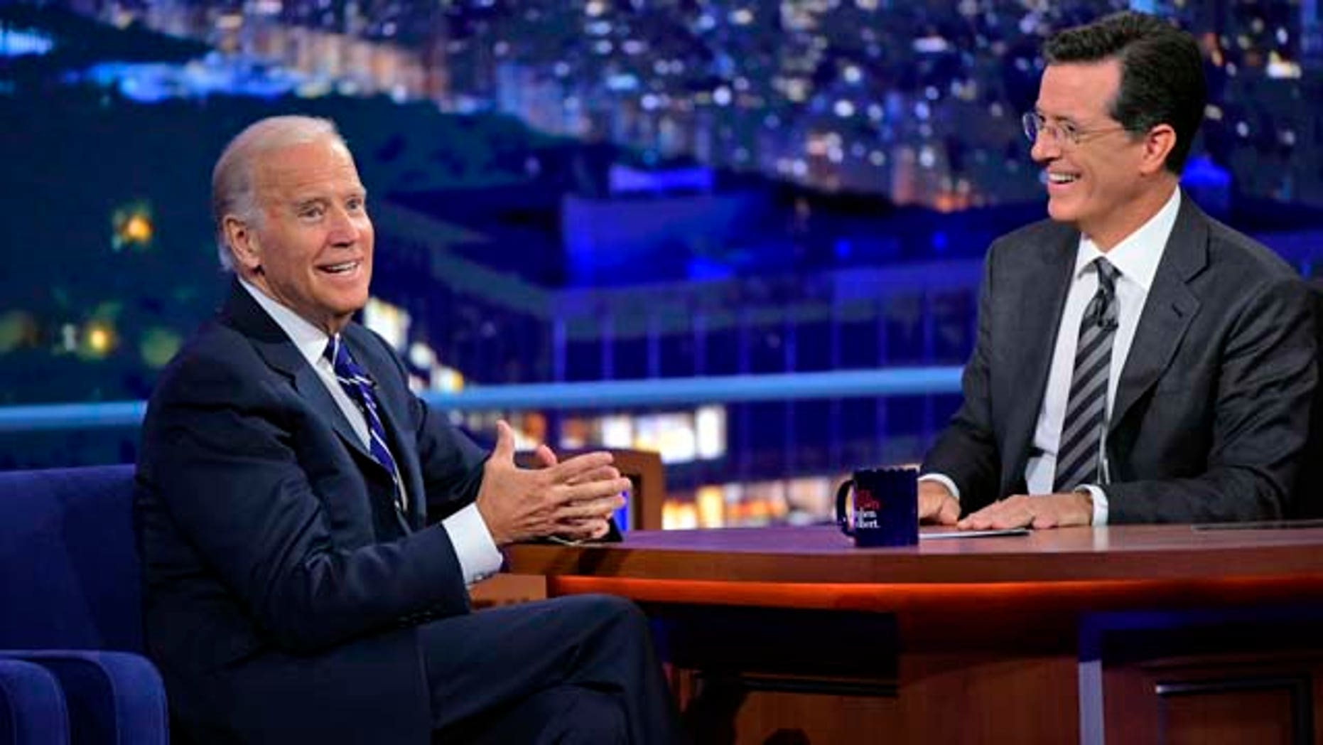 Sept. 10, 2015: In this image released by CBS, host Stephen Colbert, right, smiles as he talks with Vice President Joe Biden during a taping of 'The Late Show with Stephen Colbert,' on Thursday, Sept. 10, 2015 in New York. (John Paul Filo/CBS via AP)