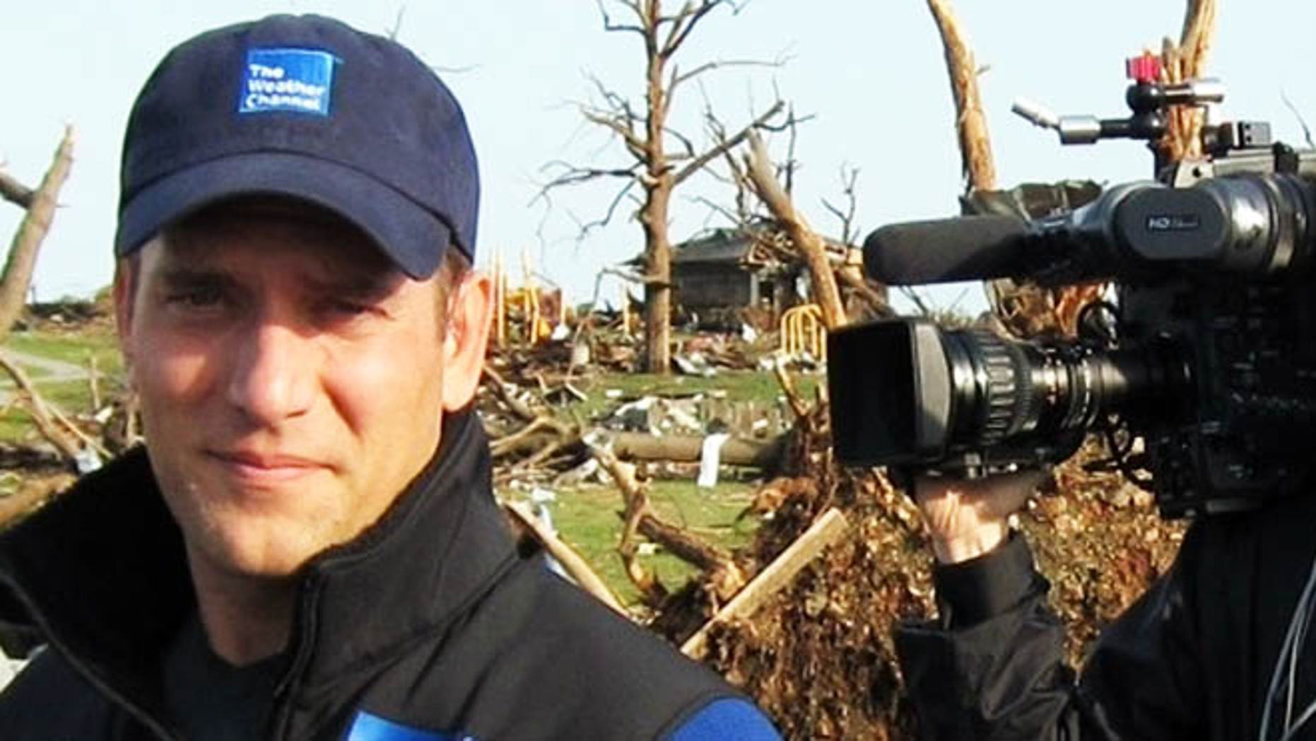 """This 2011 image released by the Weather Channel shows meteorologist Mike Bettes at the scene of a tornado in Joplin, Mo. Bettes will hit the road starting Monday for """"Tornado Week,"""" his network's version of """"Shark Week"""" thats usually its biggest scheduled programming event of the year. """"Tornado Week"""" will include a special about chasers caught up in the tornado in El Reno, Okla. A new series, """"Tornado Alley,"""" will premiere with storm footage, survivor tales and computer graphics to simulate actions of certain tornadoes. (AP Photo/Weather Channel)"""