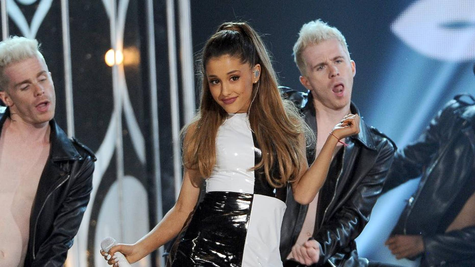 """FILE - In this May 18, 2014 file photo, Ariana Grande performs at the Billboard Music Awards at the MGM Grand Garden Arena, in Las Vegas. MTV will reprise its former """"Total Request Live"""" countdown show for a day with breakthrough pop singer Ariana Grande. The network announced Wednesday, June 25, 2014, it will bring back the series on July 2.  (Photo by Chris Pizzello/Invision/AP, file)"""