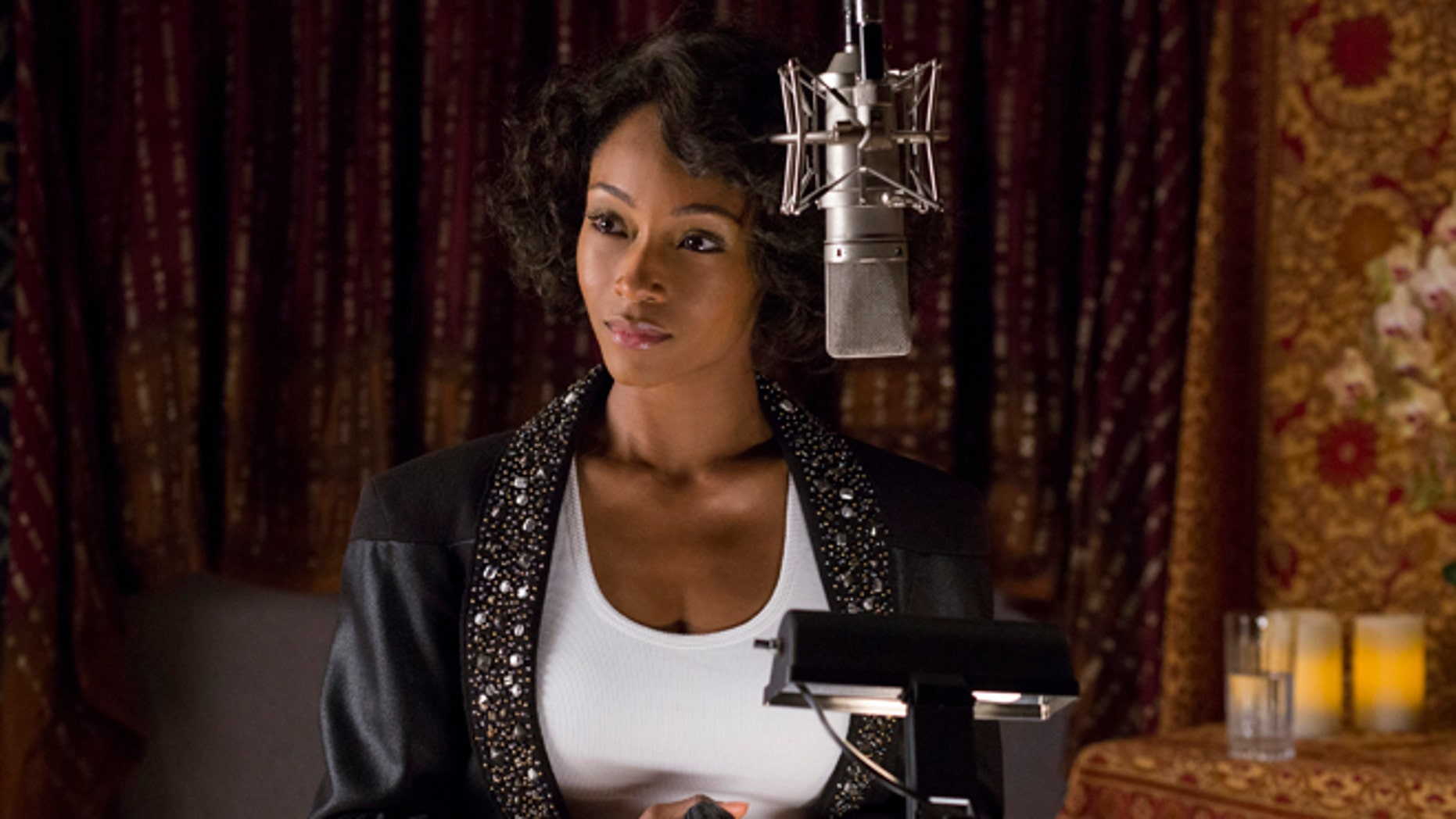 "In this image released by Lifetime, Yaya DaCosta stars as Whitney Houston in the Lifetime Original Movie, ""Whitney,"" premiering Saturday, Jan. 17, 2015 at 8pm ET/PT on Lifetime. (AP Photo/Lifetime, Jack Zeman)"