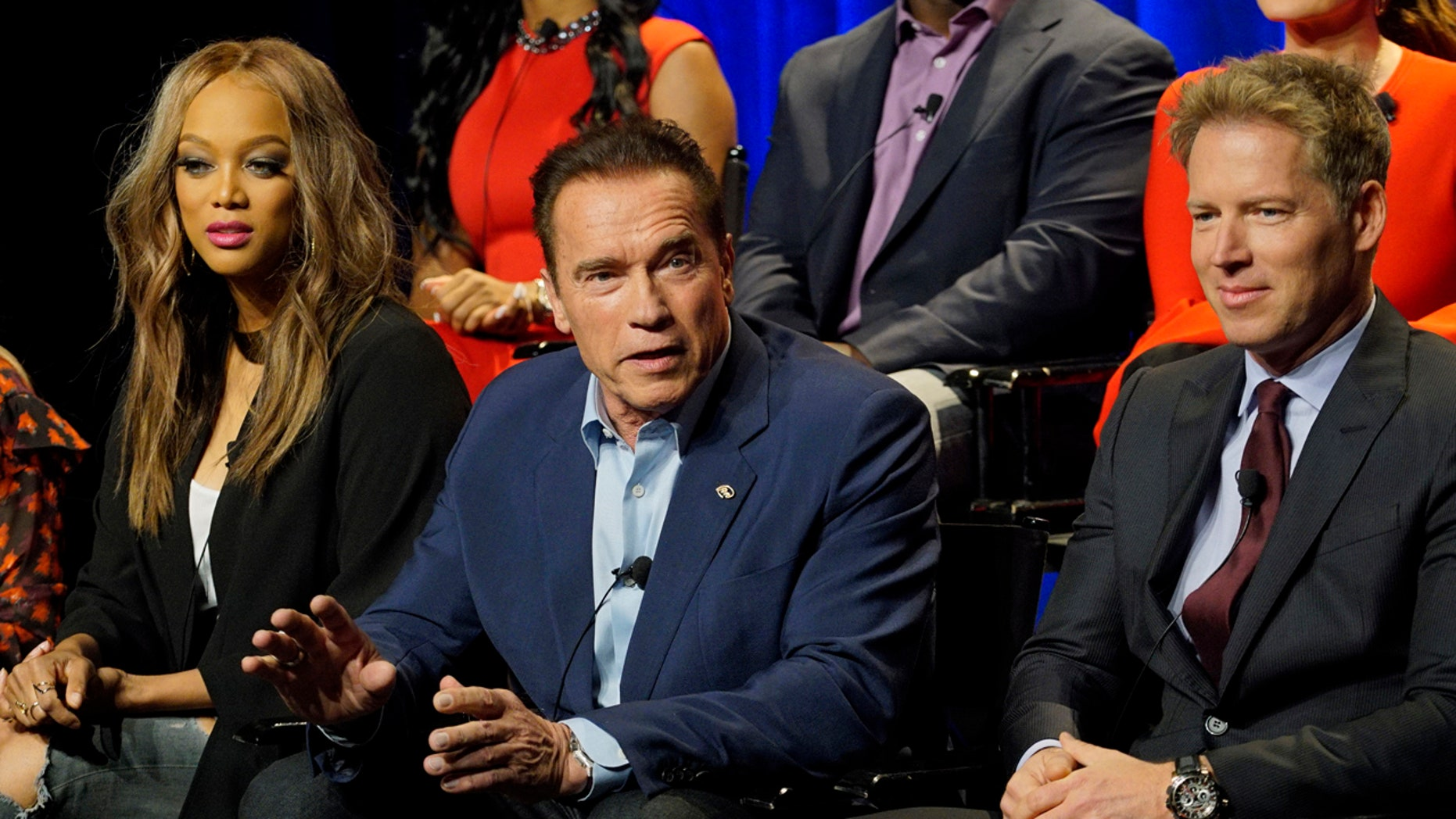 """In this Friday, Dec. 9, 2016 photo provided by NBC, Tyra Banks, from left, Arnold Schwarzenegger, Patrick Knapp Schwarzenegger attend a press junket for """"The New Celebrity Apprentice,"""" in Los Angeles."""