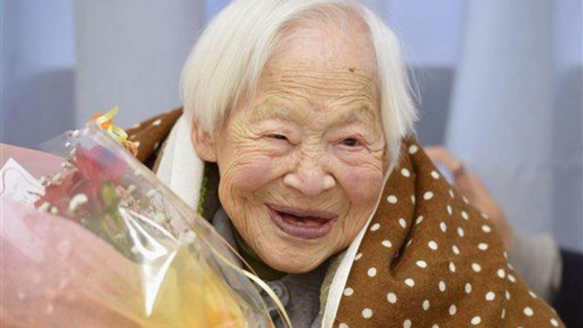 Misao Okawa celebrates her 115th birthday in Osaka, western Japan Tuesday, March 5, 2013. Okawa was formally recognized last week as the world's oldest woman.