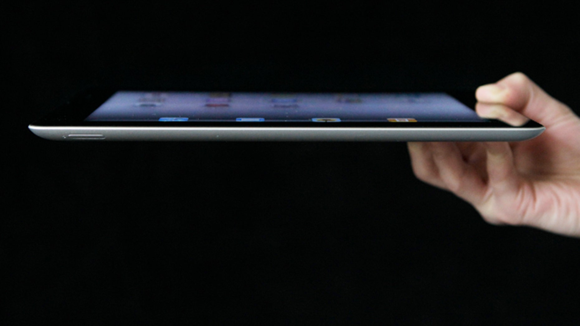 An Associated Press reporter demonstrates Apple's iPad 2 in San Francisco.