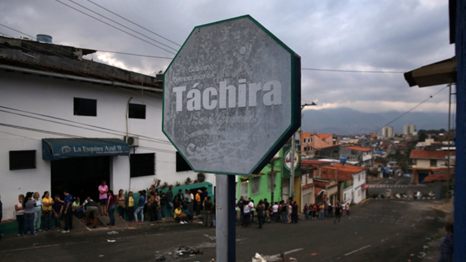 SAN CRISTOBAL, VENEZUELA - MARCH 09:  A line of people queue to buy basic foodstuffs at dawn on March 9, 2014 in San Cristobal, the capital of Tachira state, Venezuela. People often start lining up before 5am to buy items like flour, milk and sugar, which are rationed and in short supply, especially in Tachira, which borders Colombia. Tachira has been a focal point for anti-government protests nationwide.  (Photo by John Moore/Getty Images)