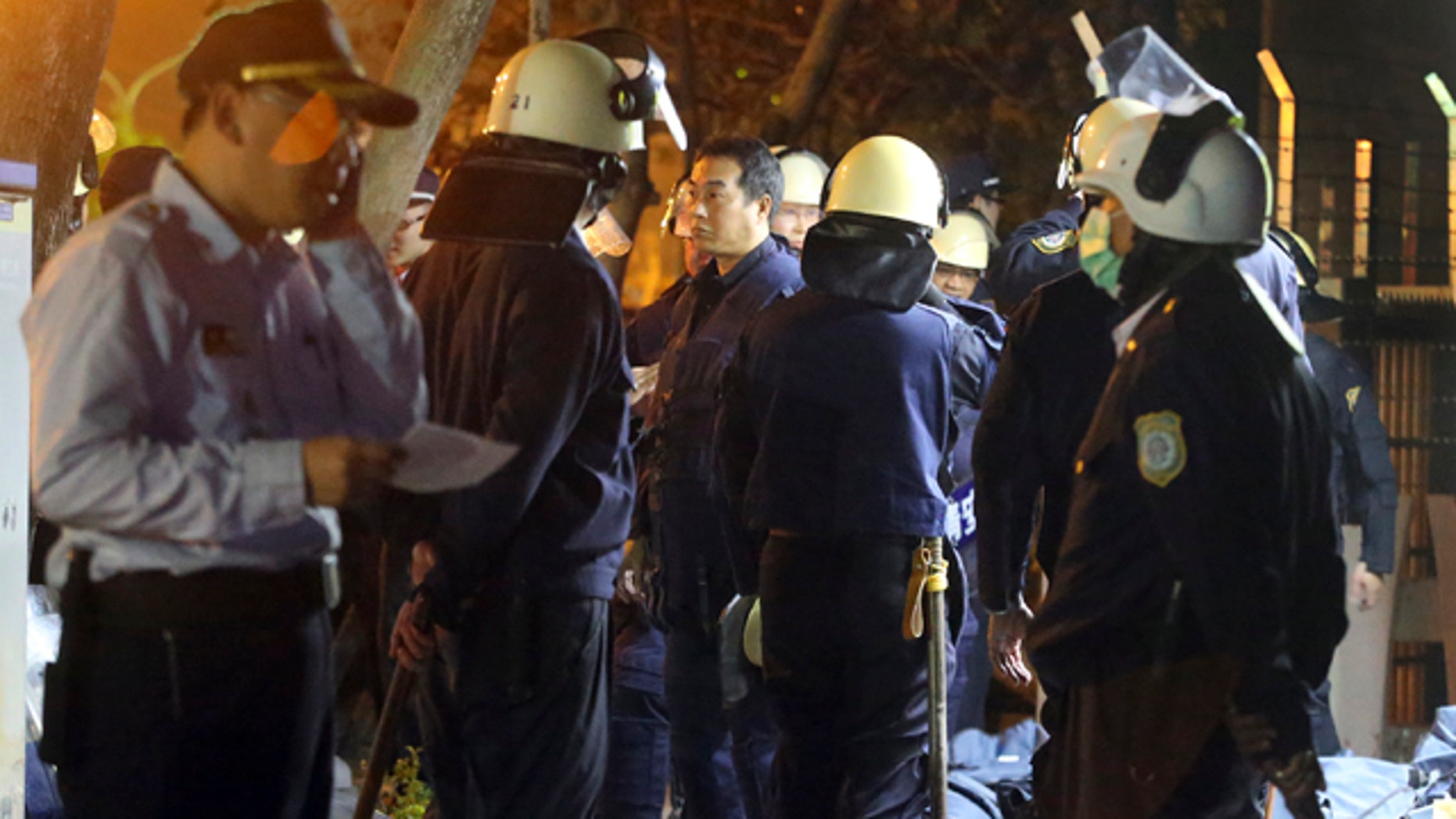 Feb. 11, 2015: Police in riot gear gather outside of a prison as prisoners hold prison staff hostage inside in Kaohsiung, Taiwan. (AP Photo)