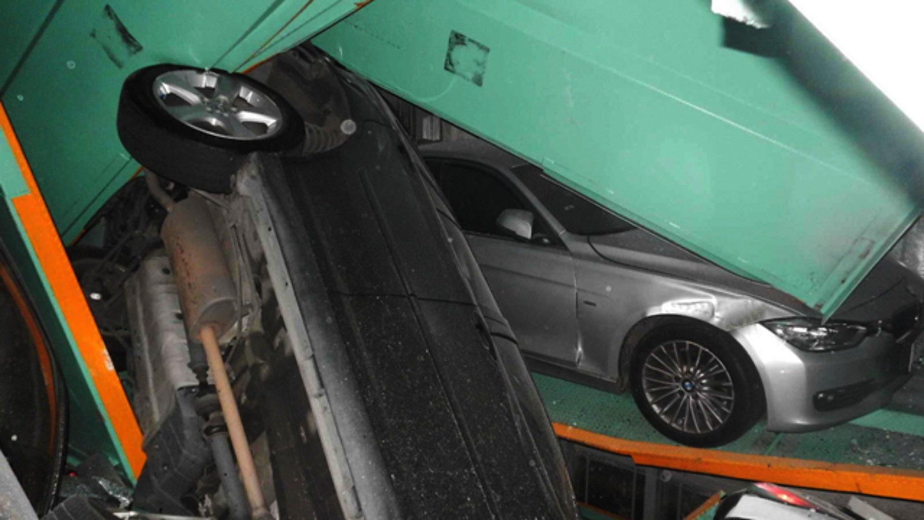 April 20, 2015: In a photo provided by the Taipei Fire Department, vehicles are seen piled on themselves in an automated parking tower after the lift system failed during the 6.3 magnitude earthquake that struck off the island's eastern coast. (Taipei Fire Department via AP)