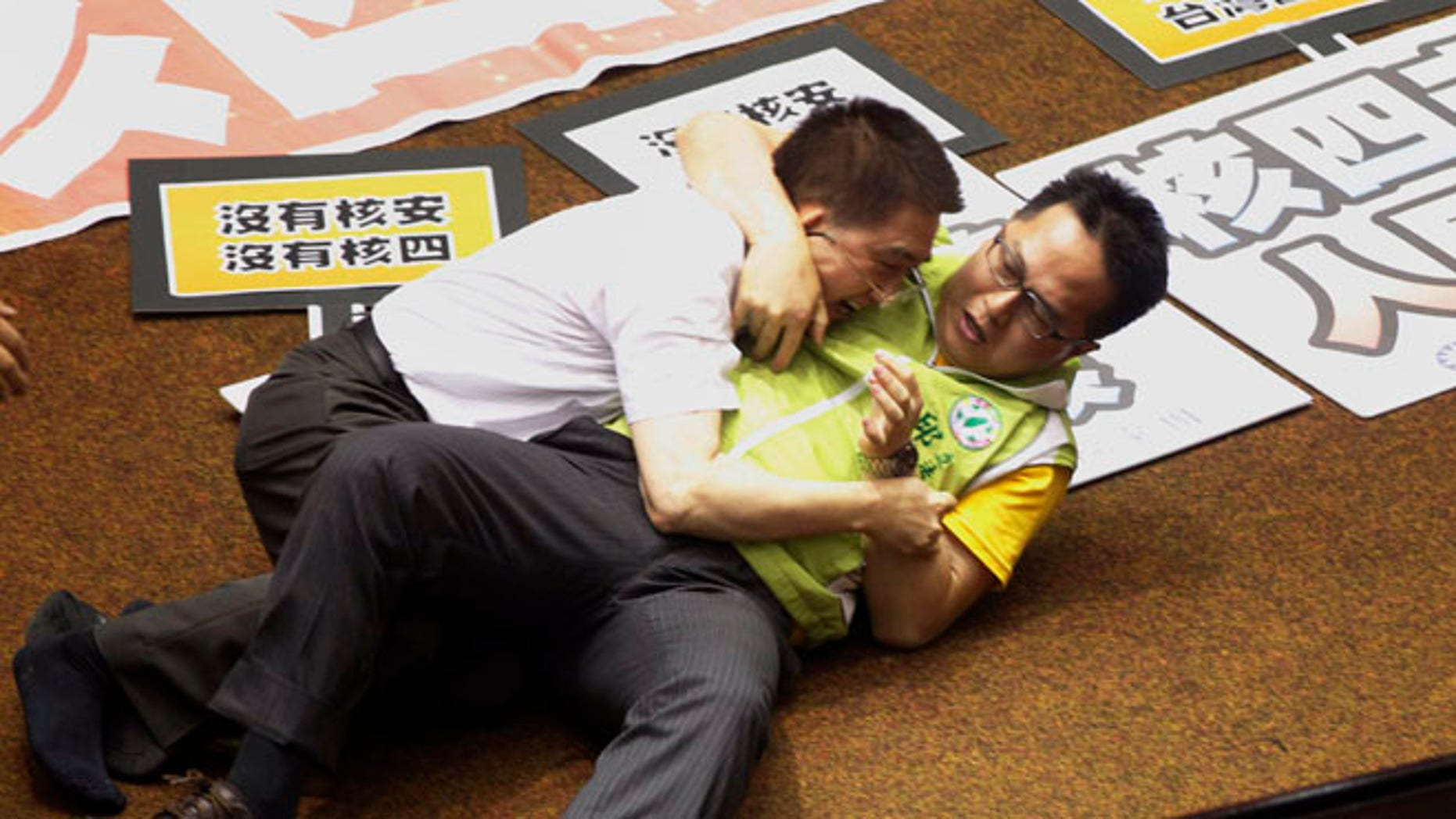 Aug 2, 2013: Ruling and opposition lawmakers fight each other on the legislature floor in Taipei, Taiwan.