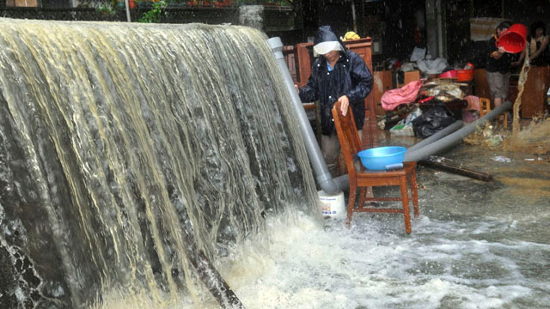 Oct. 22, 2010: Massive water and flood debris caused by rains from passing Typhoon Megi flow through a residential district in Ilan county, north eastern Taiwan.