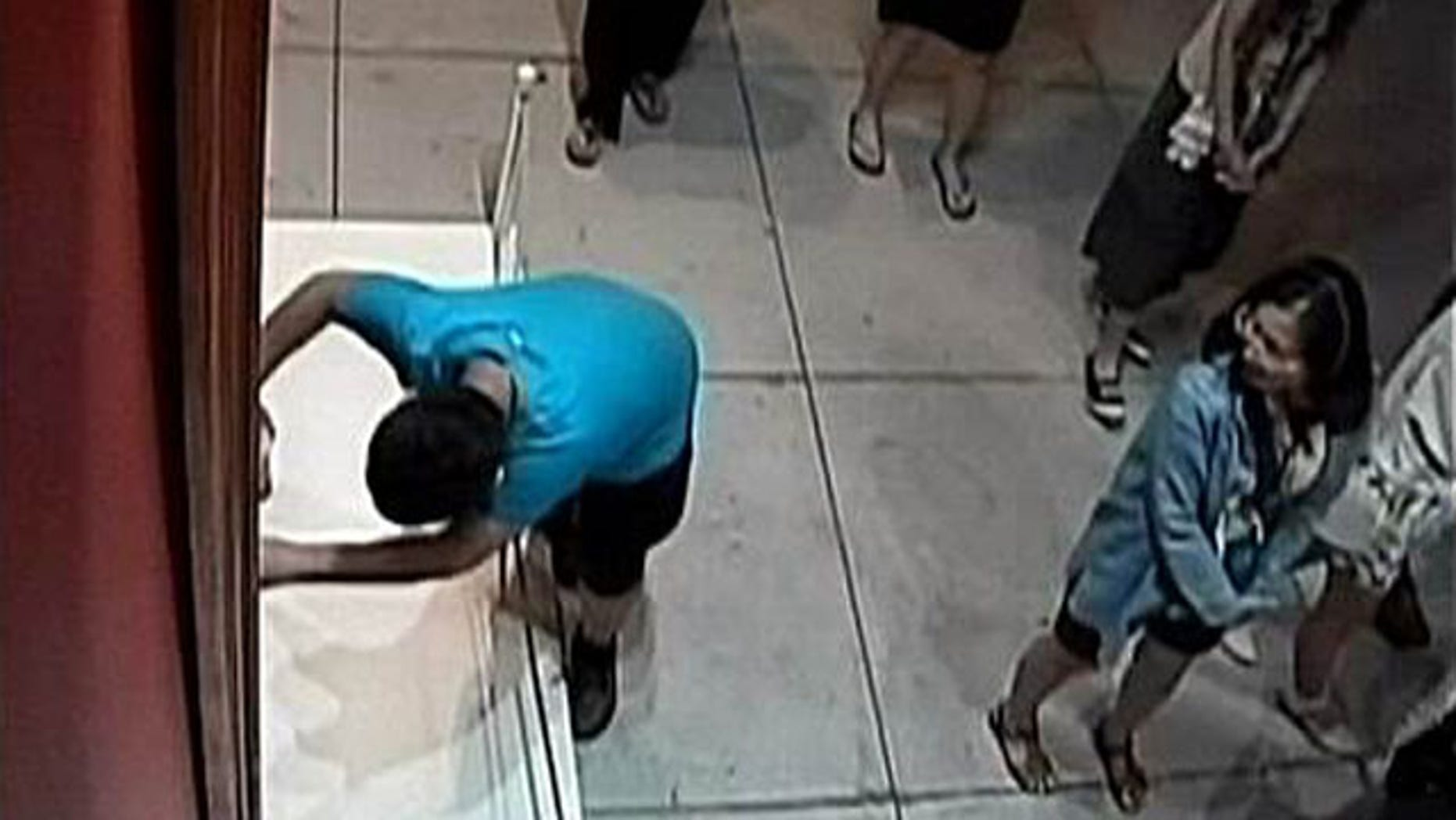 Aug. 23, 2015: In this image taken from security video, an unidentified 12-year-old boy trips and falls, damaging a 17th century Italian painting at an exhibition in Taipei, Taiwan. (Huashan 1914 Creative Park)
