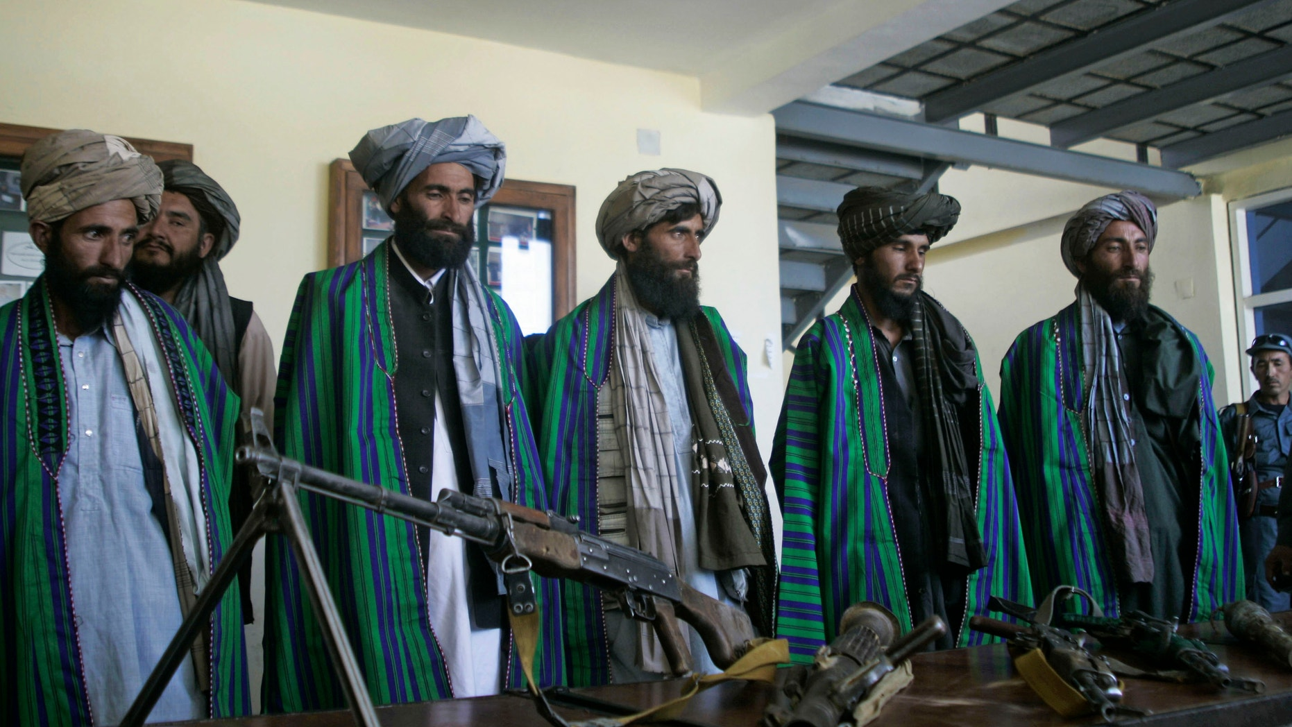 May 13, 2012: Former Taliban fighters hand over their weapons to Afghan police as part of a reconciliation process in Herat, Afghanistan.