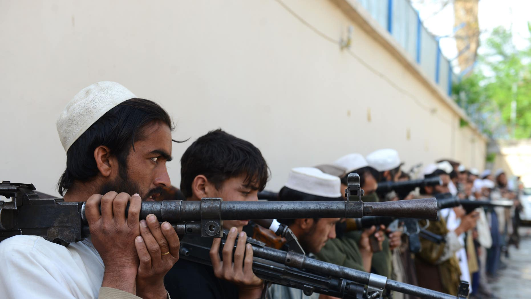 Taliban fighters hold their weapons before surrendering them to Afghan authorities in Jalalabad, Afghanistan, on March 27, 2016.