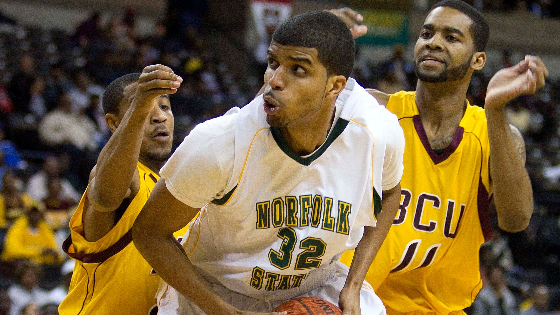 Norfolk State's Marcos Tamares (32) is guarded by Bethune-Cookman Kevin Dukes (21) and Javoris Bryant (11) during the first half of an NCAA college basketball game in the championship of the Mid-Eastern Athletic Conference tournament in Winston-Salem, NC., Saturday, March 10, 2012.