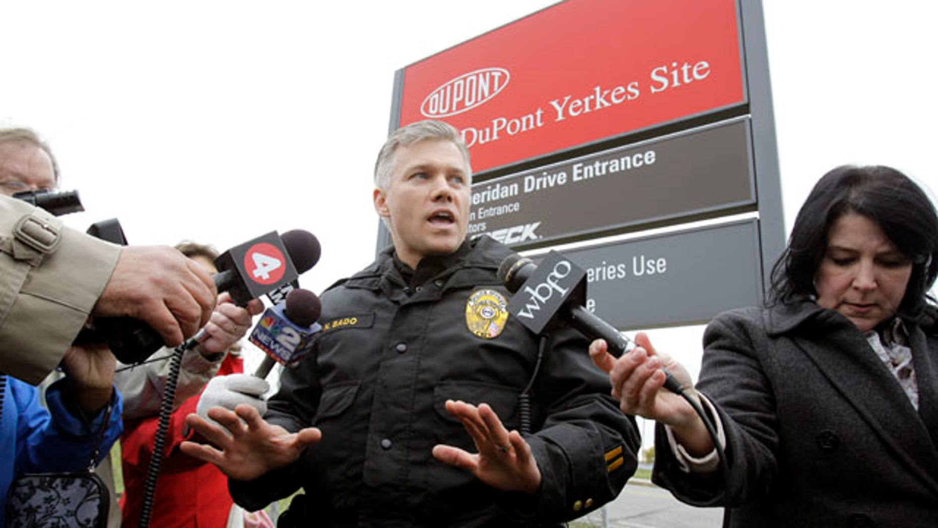 Nov. 9: Tonawanda police officer Nicholas Bado speaks during a news conference at the site of a small tank explosion at a DuPont plant in Tonawanda, N.Y. Police say the explosion killed one worker, injured another and forced part of the building to be evacuated.