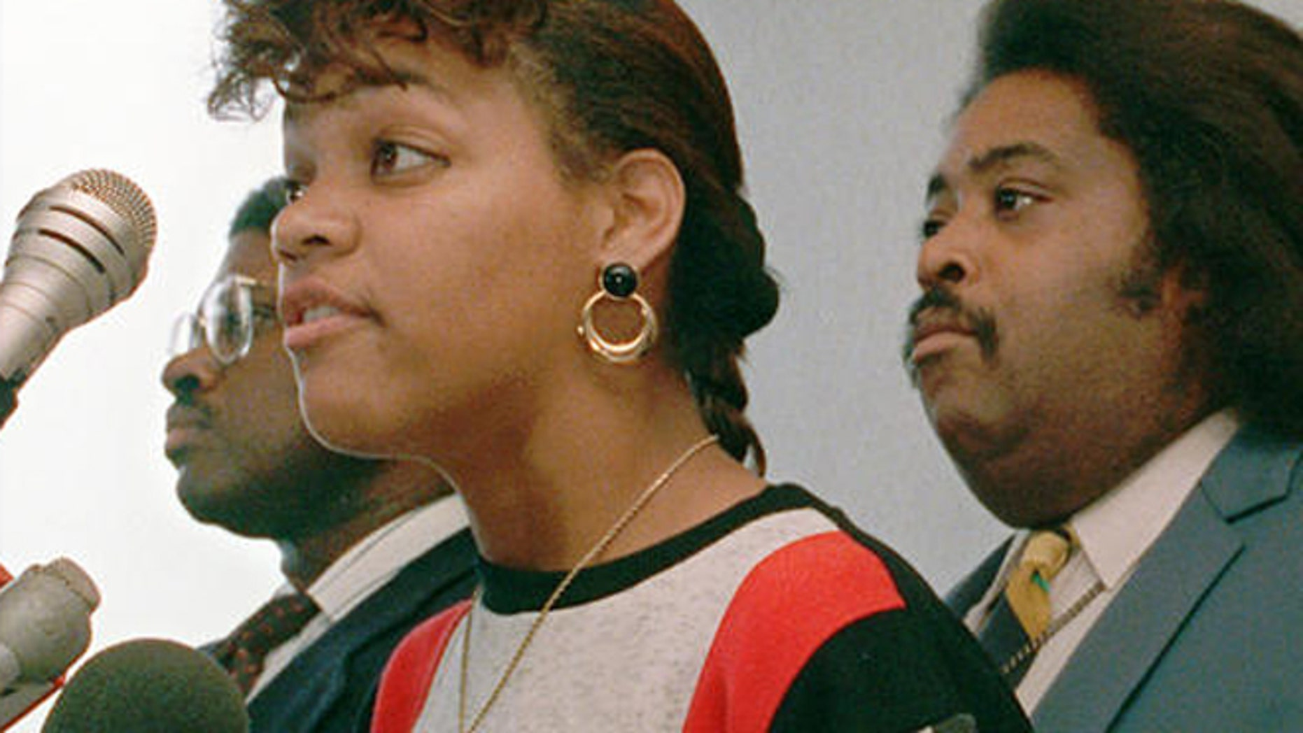 Sept. 28, 1988: Tawana Brawley is flanked by attorney Alton Maddox, left, and the Rev. Al Sharpton as she faces the media.
