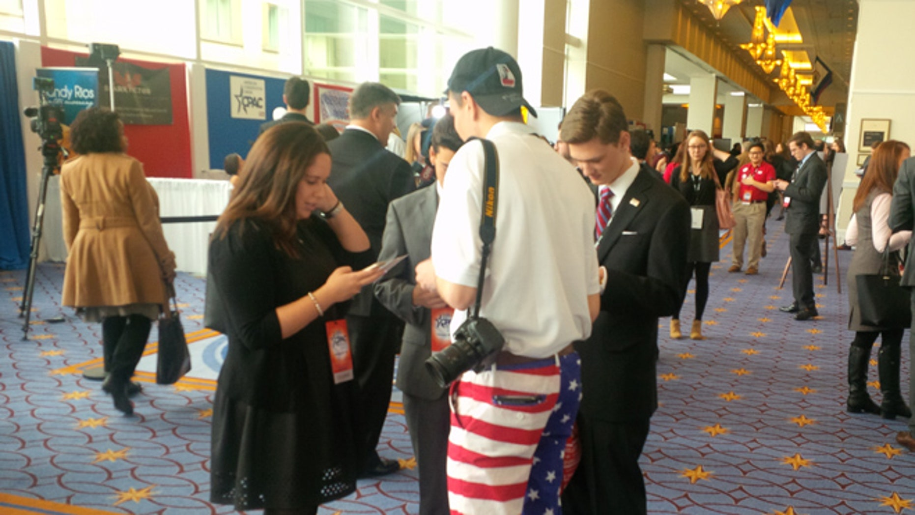 FILE: Feb.25, 2015: This year's CPAC gathering, like others in the past, attracted members of the Tea Party movement. Oxon Hill, Md.