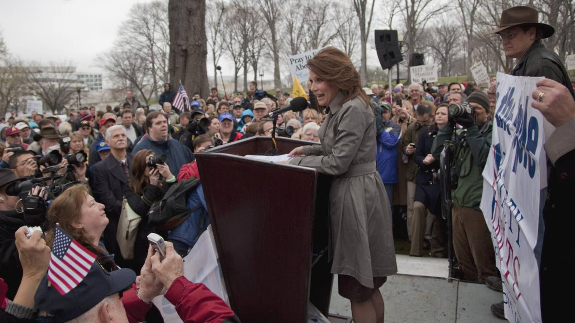 "Rep. Michele Bachmann, R-Minn. addresses the Tea Party ""Continuing Revolution Rally"" on Capitol Hill in Washington, Thursday, March 31, 2011. (AP Photo/Evan Vucci)"